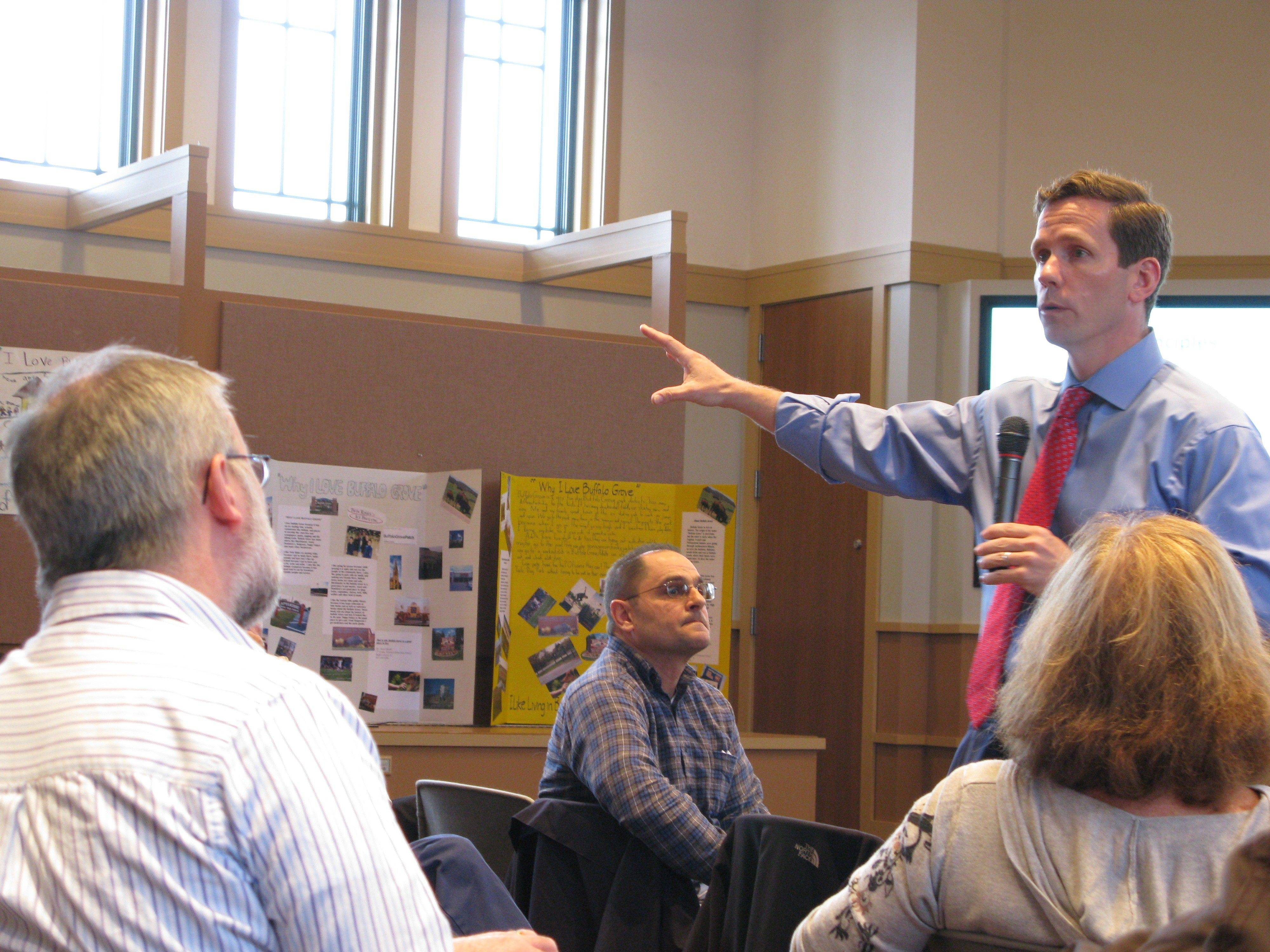 Congressman Robert Dold talks to constituents at a town-hall meeting Saturday in Buffalo Grove.