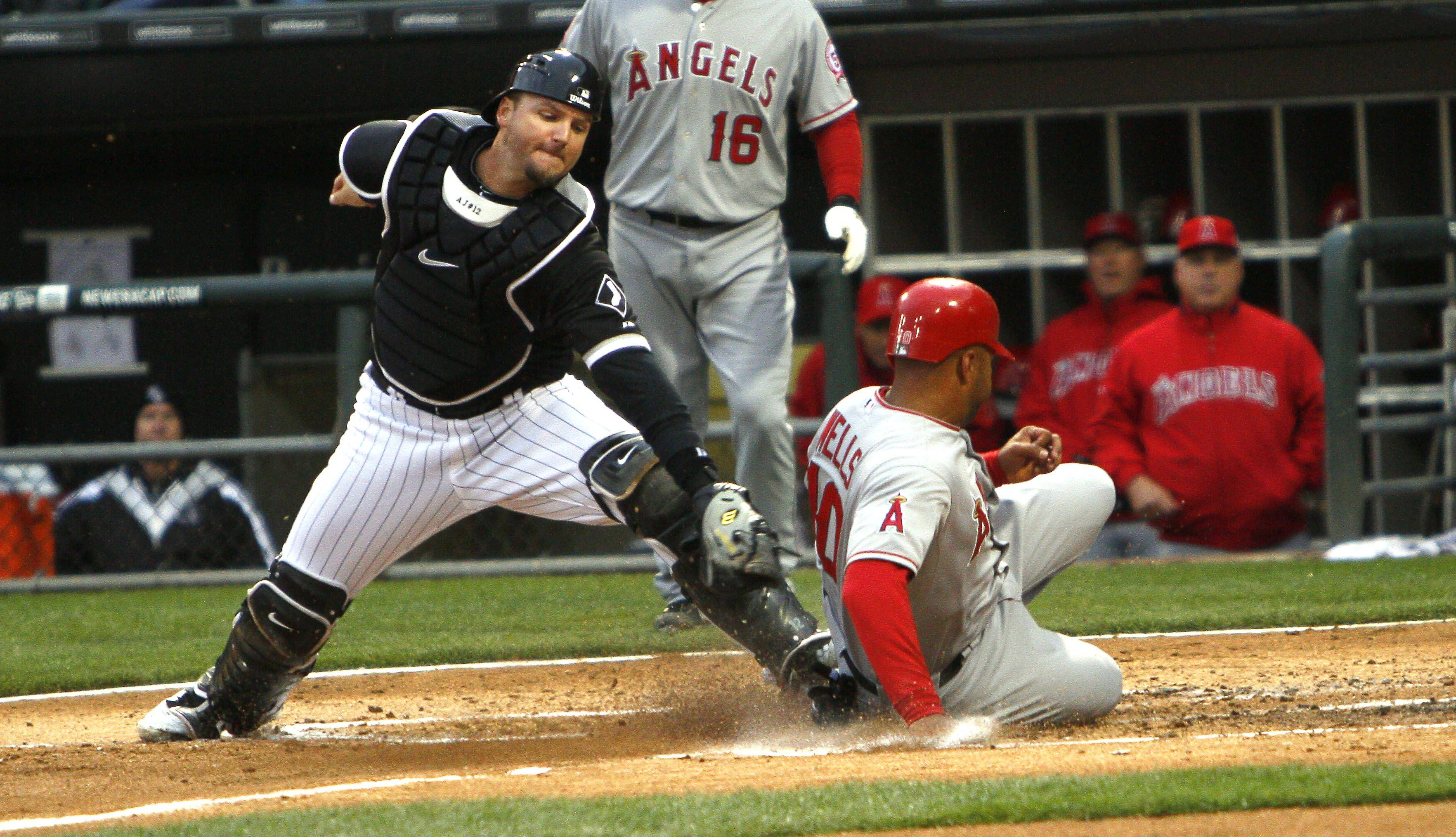 A.J. Pierzynski can't make tag on Los Angeles Angels' Vernon Wells who scores on a wild pitch in the second inning of a baseball game on Saturday.