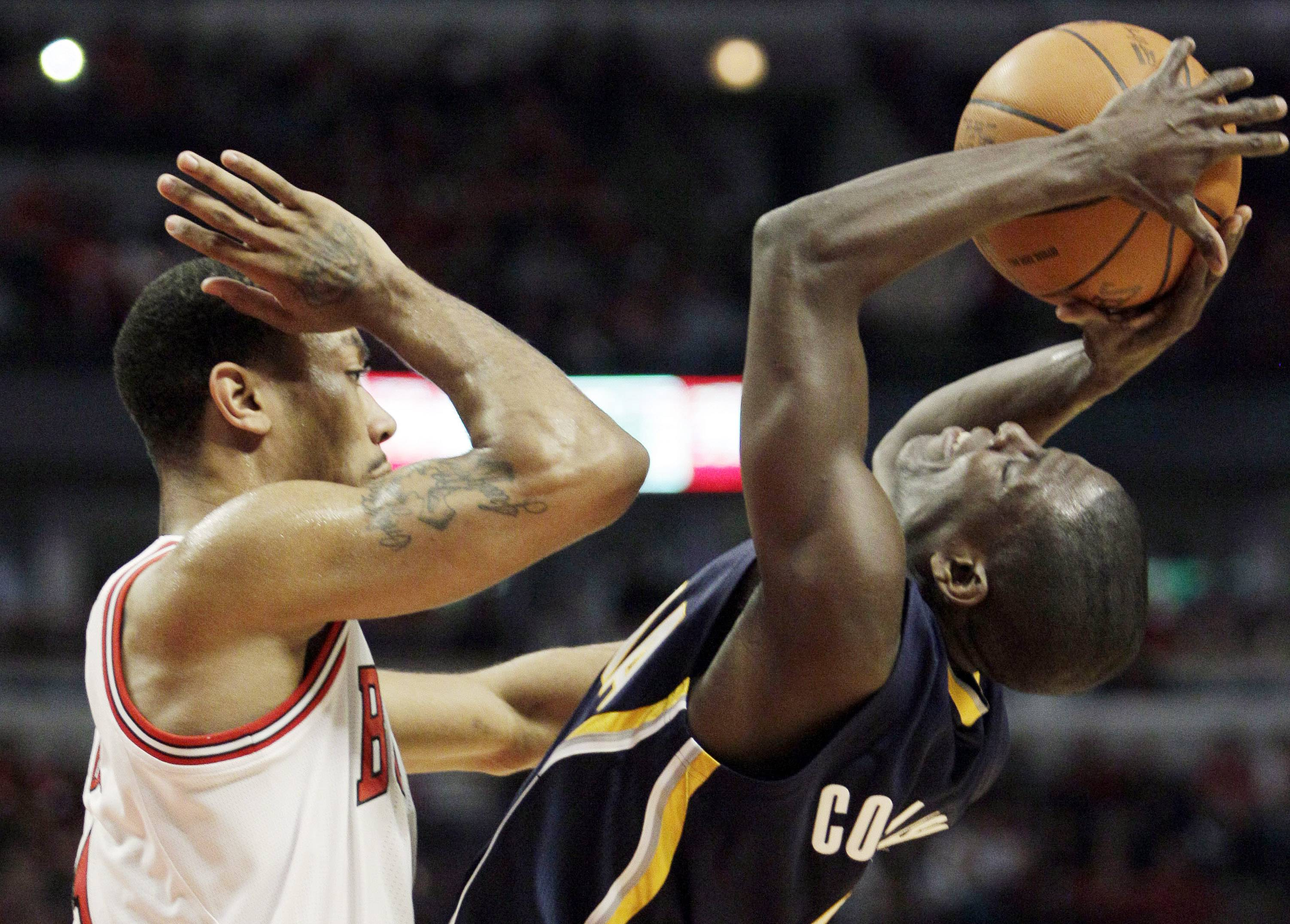 Derrick Rose defends against the Indiana Pacers' Darren Collison during the second quarter in Game 1 Saturday.