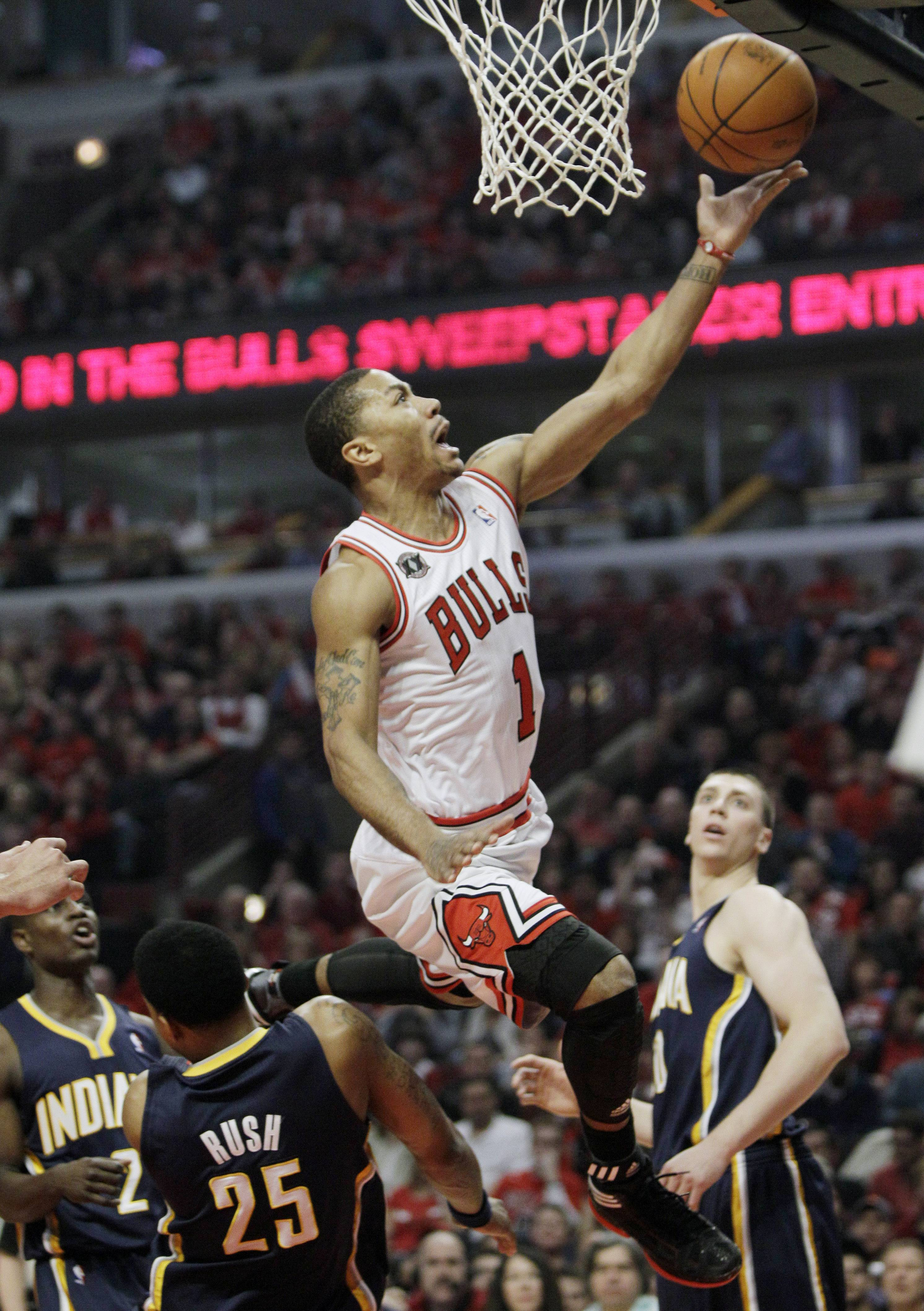 Derrick Rose drives to the basket against the Indiana Pacers during the first quarter in Game 1 Saturday.
