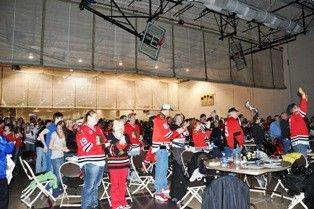 Fans who attended a Blackhawks party at the Libertyville Sports Complex last week react to action from the Blackhawks' game against Detroit, which was shown on a large screen.