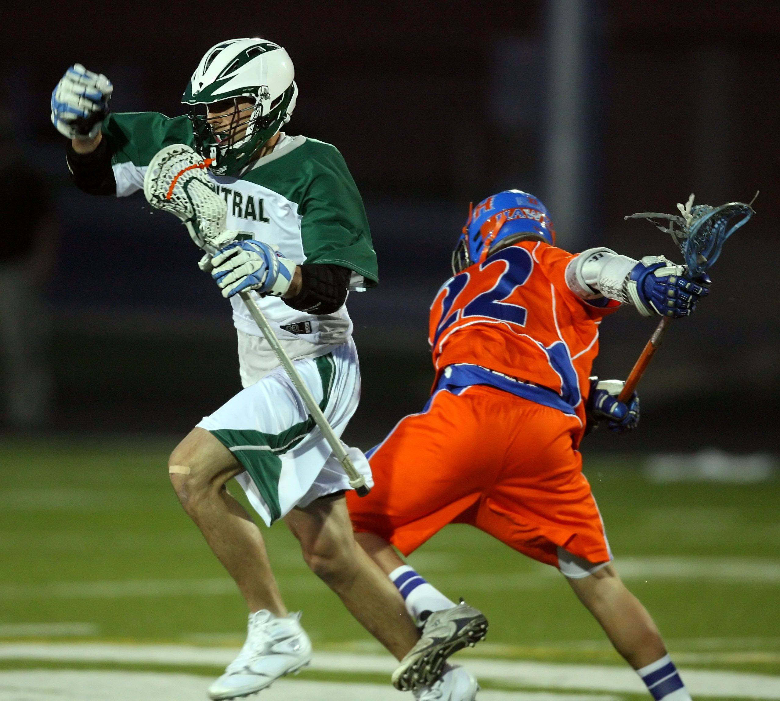 Grayslake Central's Jake Paust drives past Hoffman Estates' Steven Gliniewicz during their game Wednesday night at Grayslake Central High School.