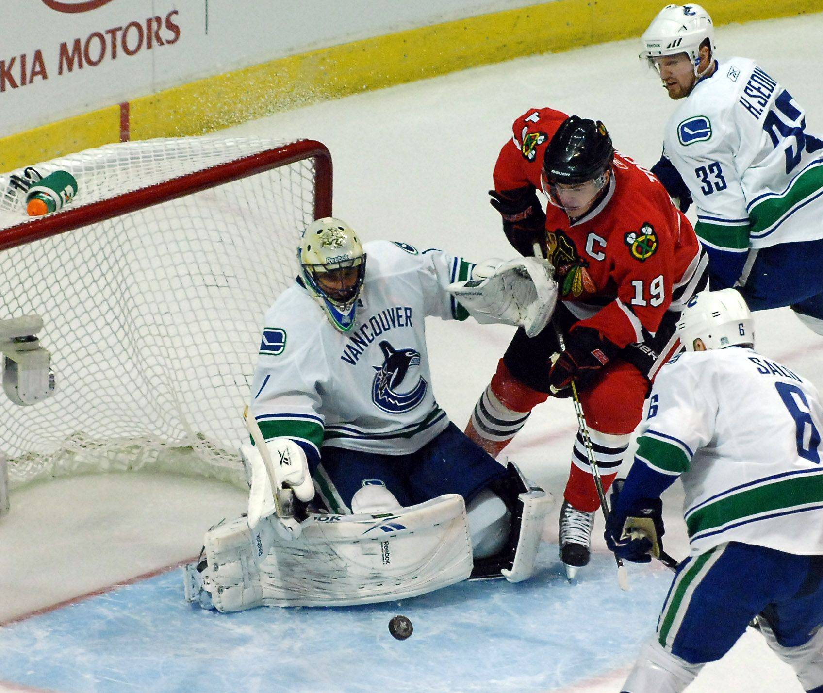 Chicago Blackhawks center Jonathan Toews is stymied in front of the goal by Vancouver Canucks goalie Roberto Luongo.
