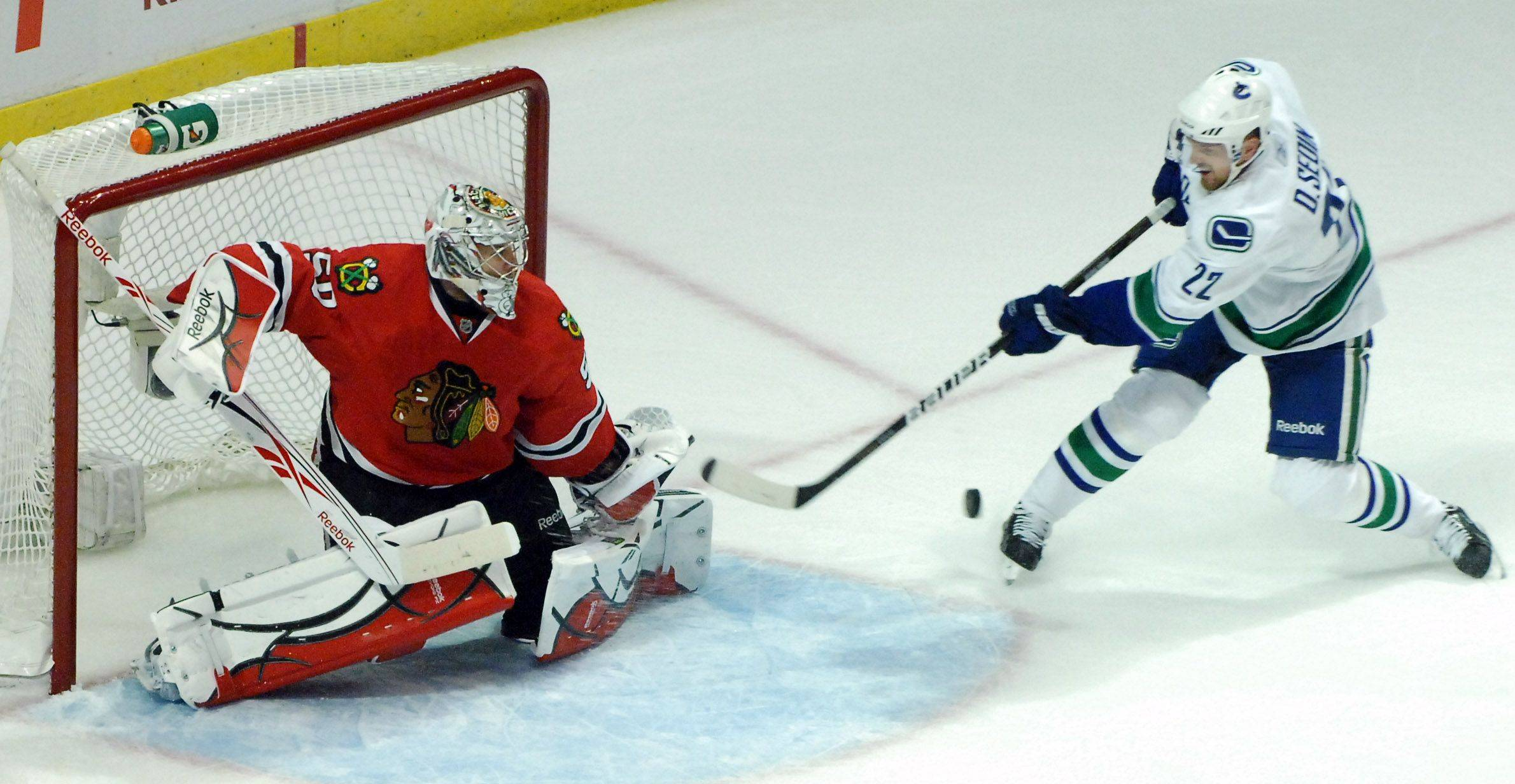 Chicago Blackhawks goalie Corey Crawford makes a save on a shot by Vancouver Canucks left wing Daniel Sedin in the second period.