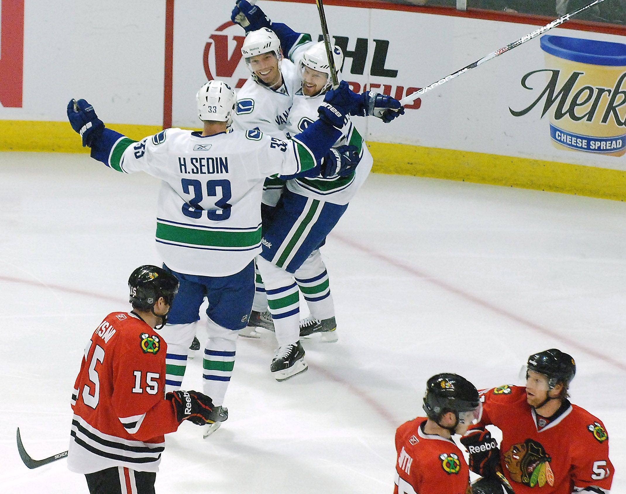 The Vancouver Canucks celebrate what turned out to be the winning goal by Mikael Samuelsson during Game Three of the NHL Western Conference Quarterfinals.