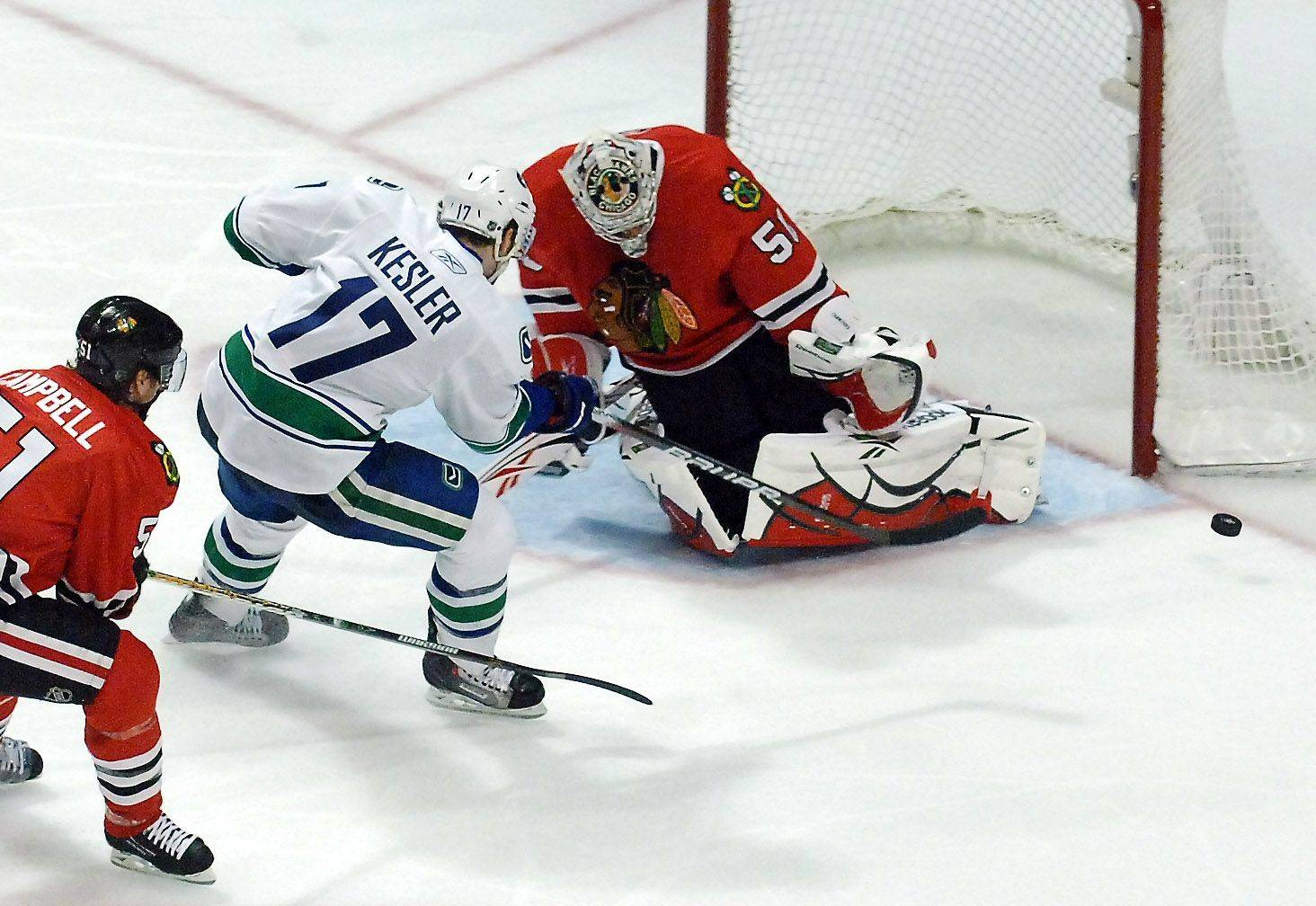 Chicago Blackhawks goalie Corey Crawford (50) stops Vancouver Canucks center Ryan Kesler (17) on a breakaway in the third period.