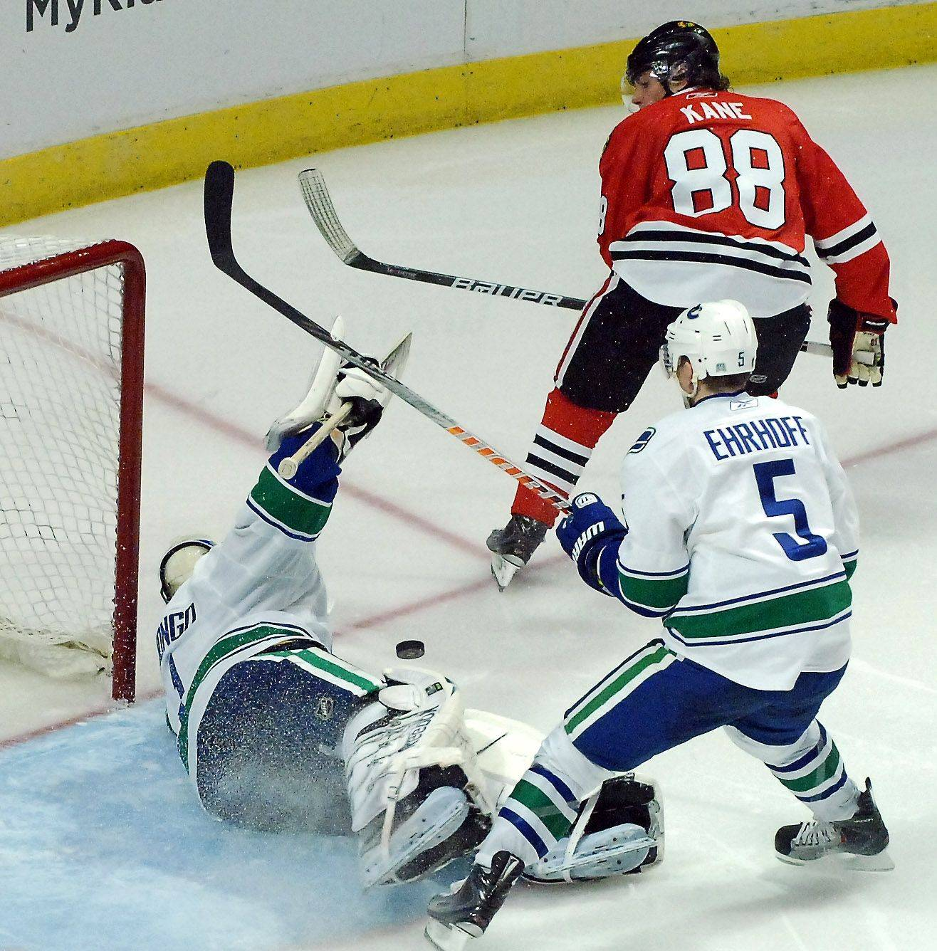 Chicago Blackhawks right wing Patrick Kane (88) has his shot turned away by Vancouver Canucks goalie Roberto Luongo (1) in the third period.