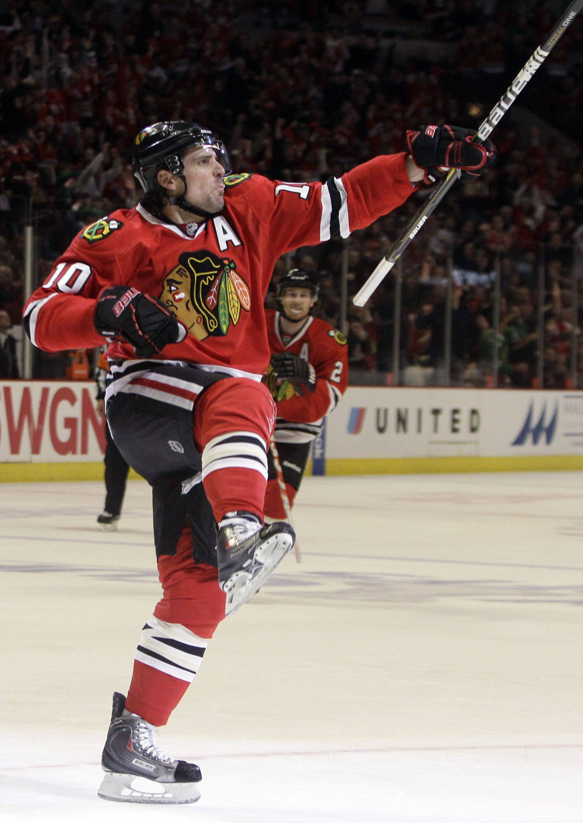 Chicago Blackhawks' Patrick Sharp celebrates after scoring his goal during the second period.