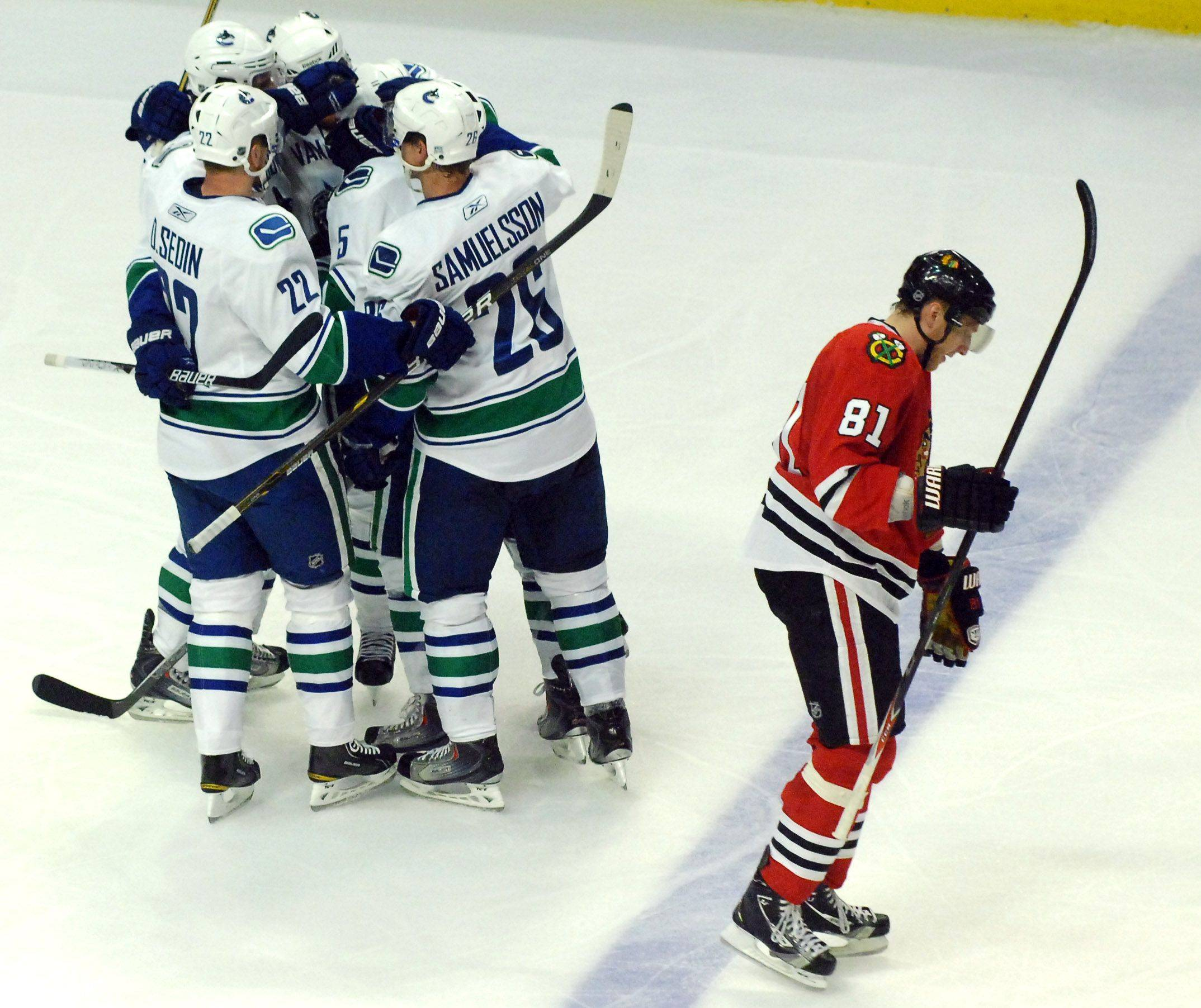 The Vancouver Canucks celebrate their first goal of the game during Game Three of the NHL Western Conference Quarterfinals Sunday.