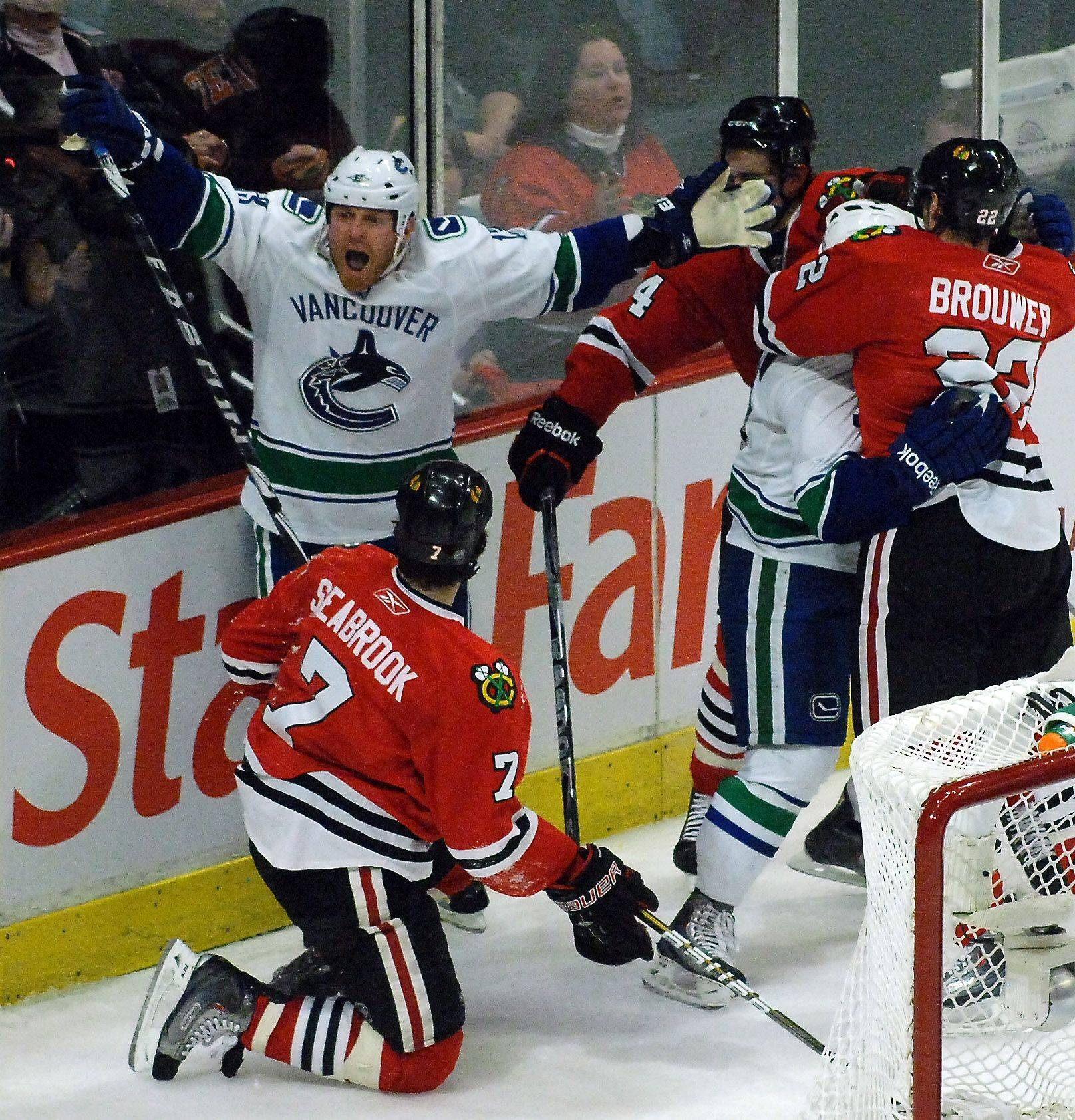 Vancouver Canucks left wing Raffi Torres (reacts to his penalty for hitting Chicago Blackhawks defenseman Brent Seabrook