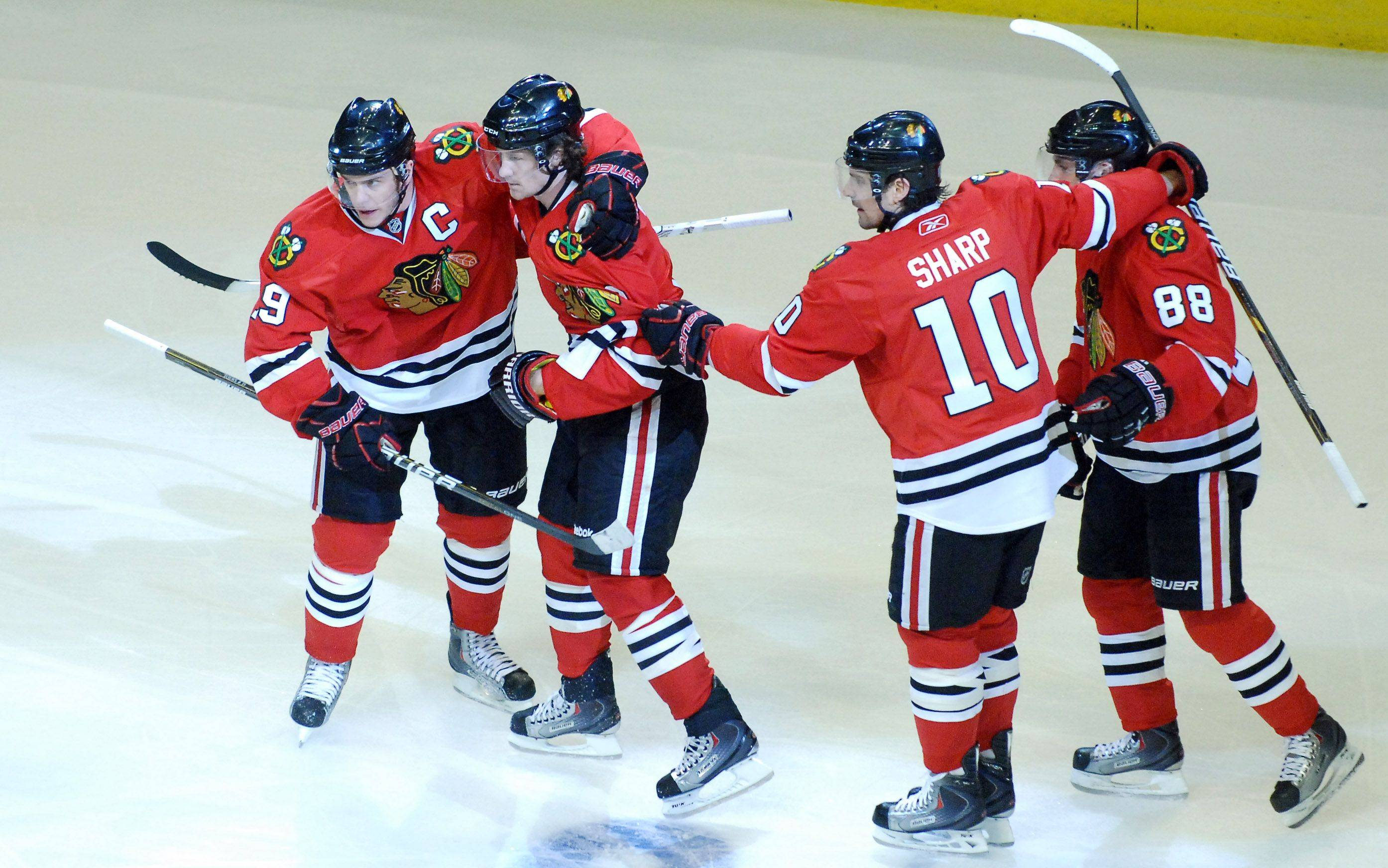 Teammates congratulate Chicago Blackhawks defenseman Duncan Keith (2, second from left) following his first period goal.