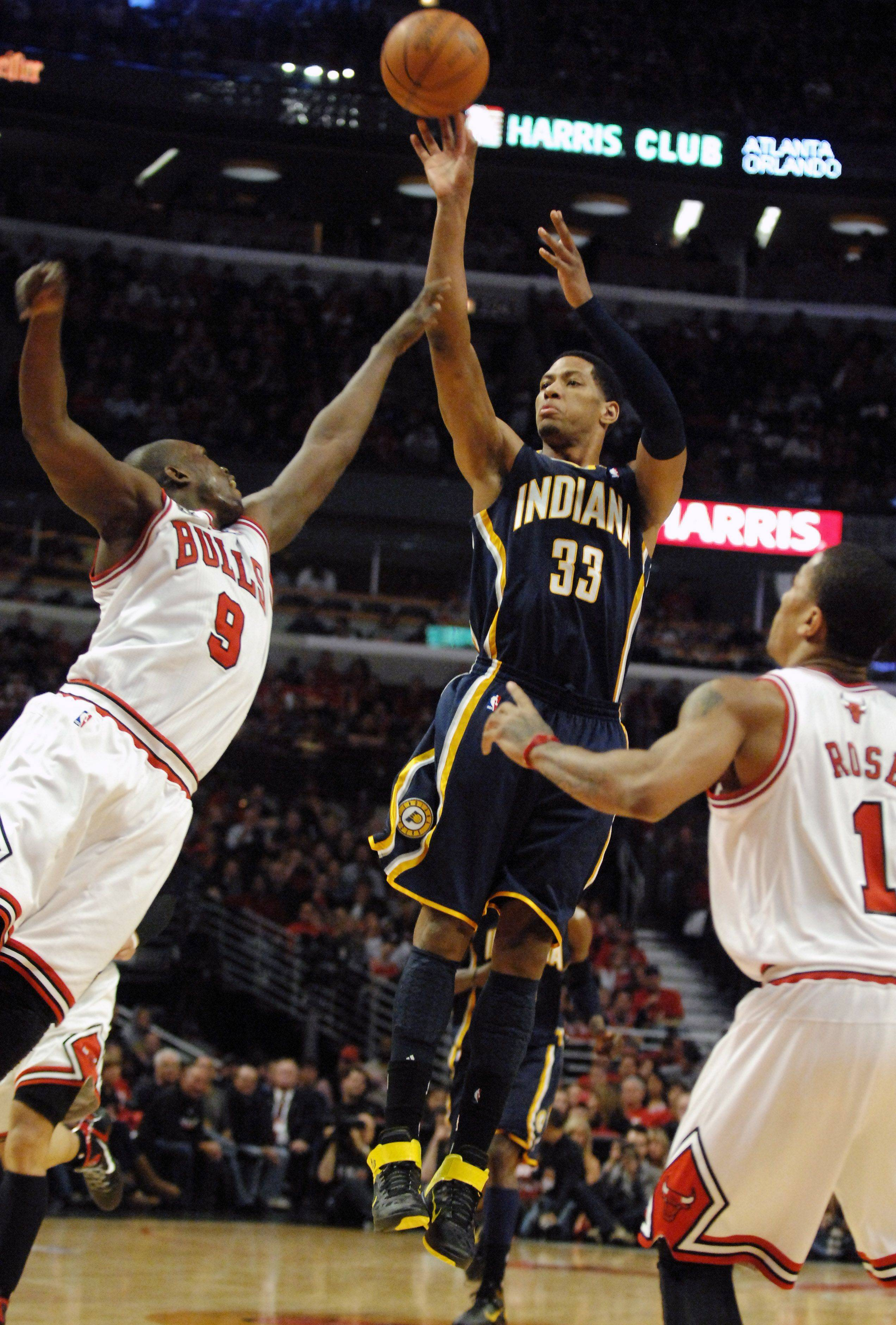 Indiana Pacers small forward Danny Granger (33) drains a three-pointer over Chicago Bulls small forward Luol Deng (9) during Game One of the NBA Eastern Conference Quarterfinals Saturday at the United Center in Chicago.