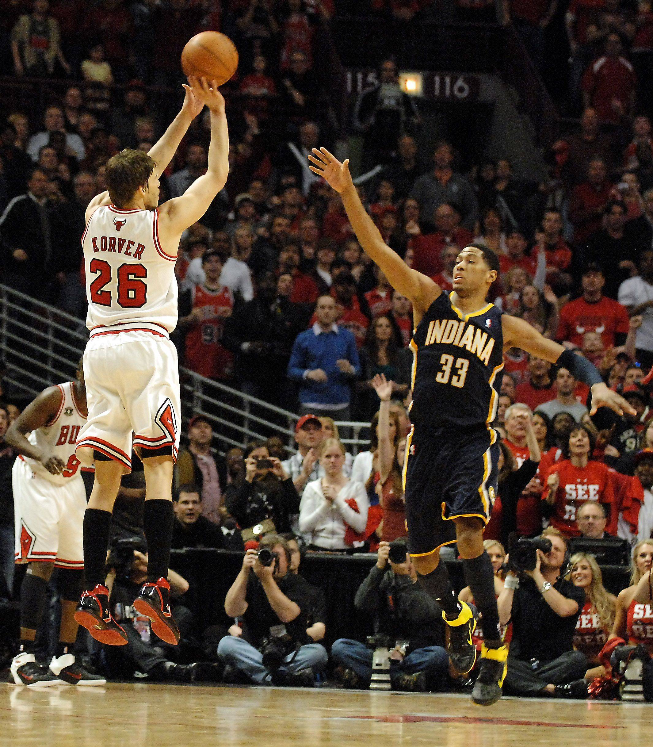 Chicago Bulls shooting guard Kyle Korver (26) hits a go-ahead 3-pointer over Indiana Pacers small forward Danny Granger (33) late in the 4th quarter during Game One of the NBA Eastern Conference Quarterfinals Saturday at the United Center in Chicago.