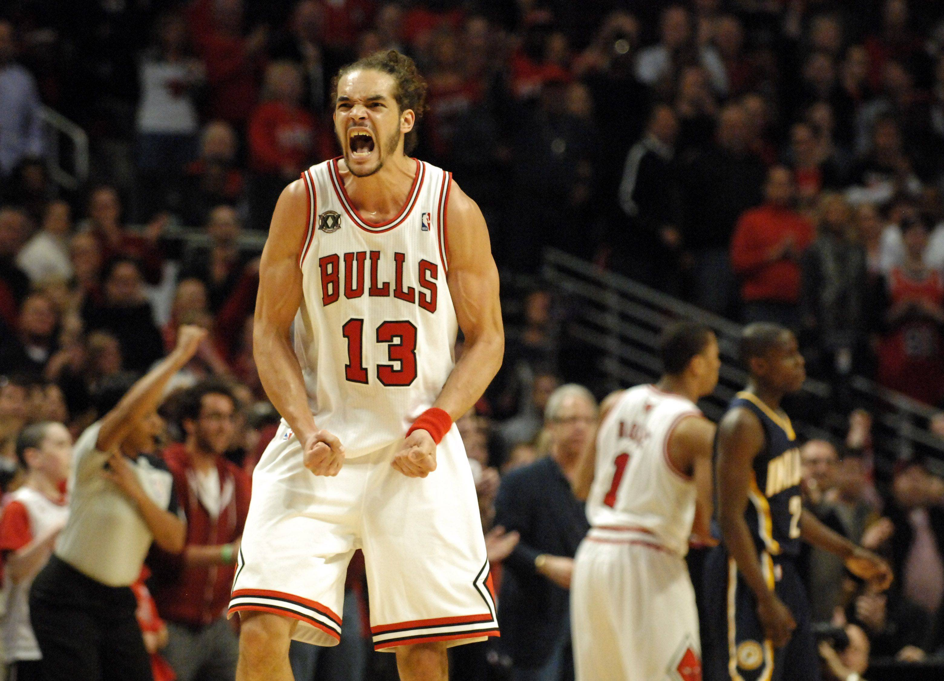 Chicago Bulls center Joakim Noah (13) celebrates after a foul of teammate Derrick Rose esentially ices the game against the Indiana Pacers during Game One of the NBA Eastern Conference Quarterfinals Saturday at the United Center in Chicago.