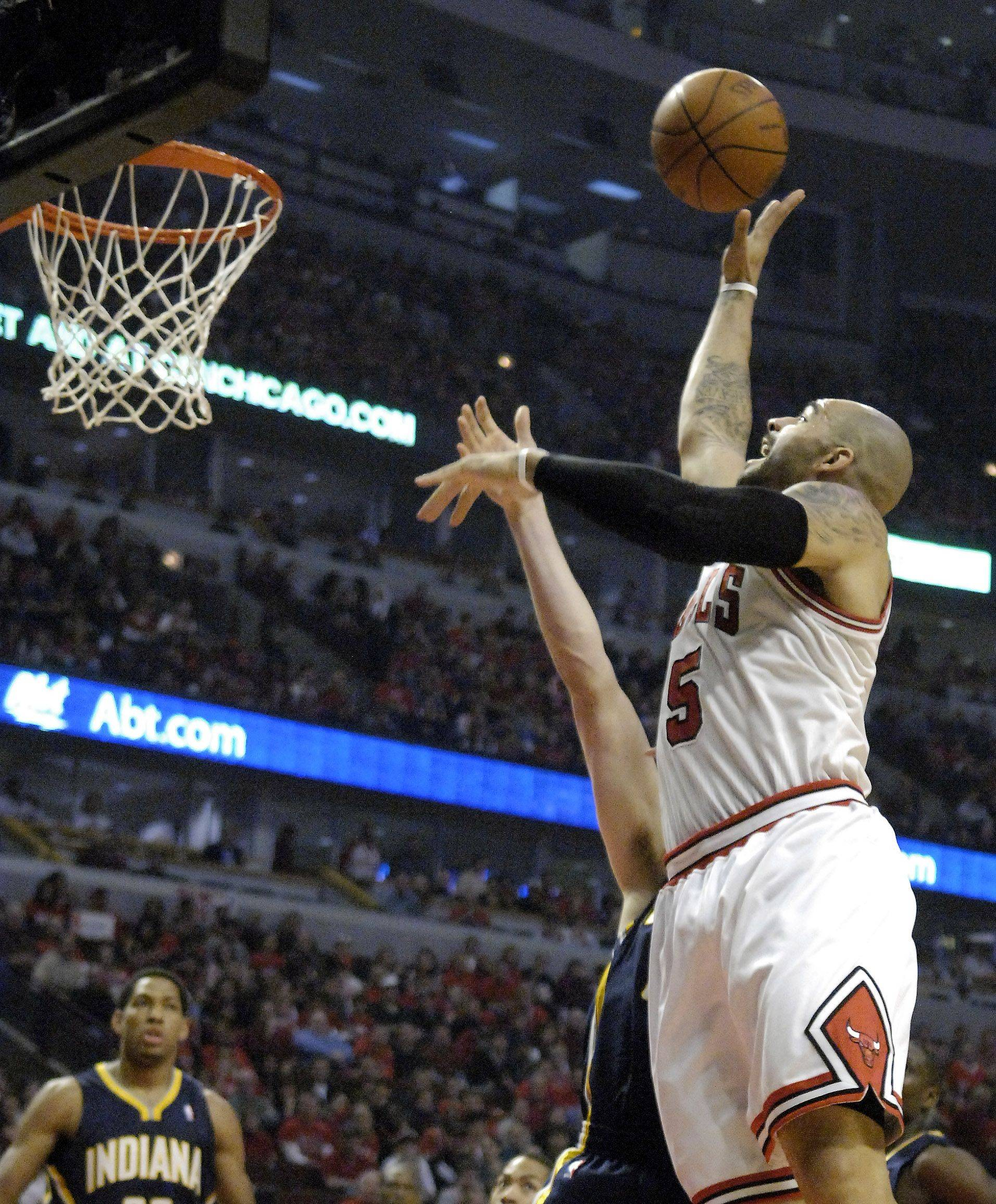 Chicago Bulls power forward Carlos Boozer (5) puts up a shot during Game One of the NBA Eastern Conference Quarterfinals Saturday at the United Center in Chicago.