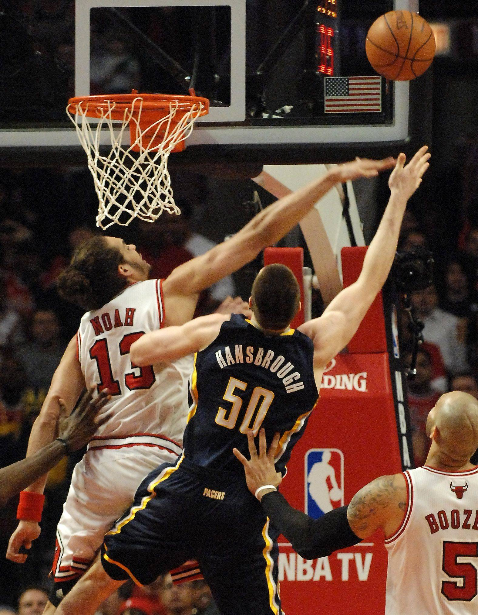 Chicago Bulls center Joakim Noah (13) blocks a shot by Indiana Pacers power forward Tyler Hansbrough (50) during Game One of the NBA Eastern Conference Quarterfinals Saturday at the United Center in Chicago.