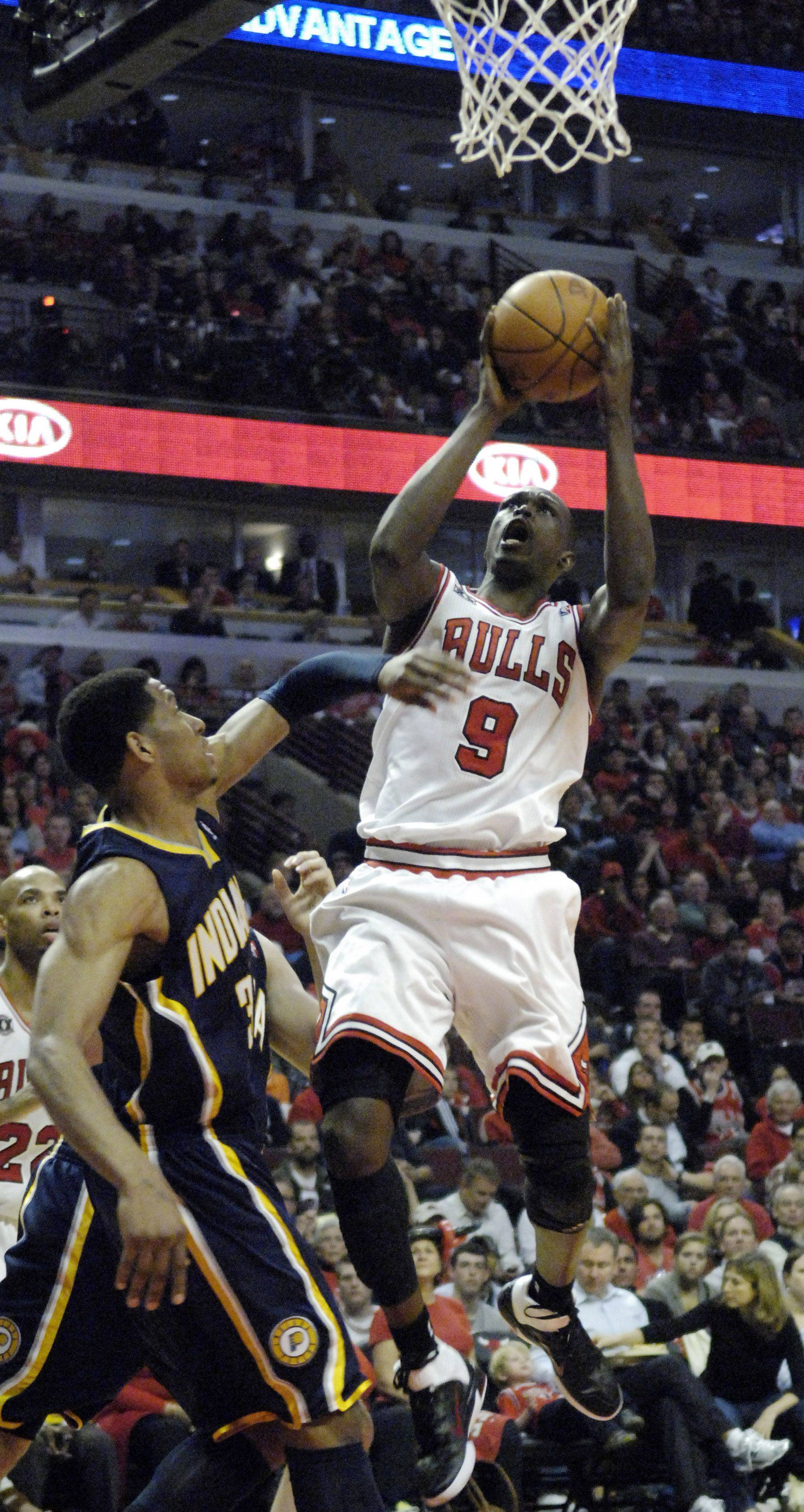 Chicago Bulls small forward Luol Deng (9) glides in for a layup during Game One of the NBA Eastern Conference Quarterfinals Saturday at the United Center in Chicago.