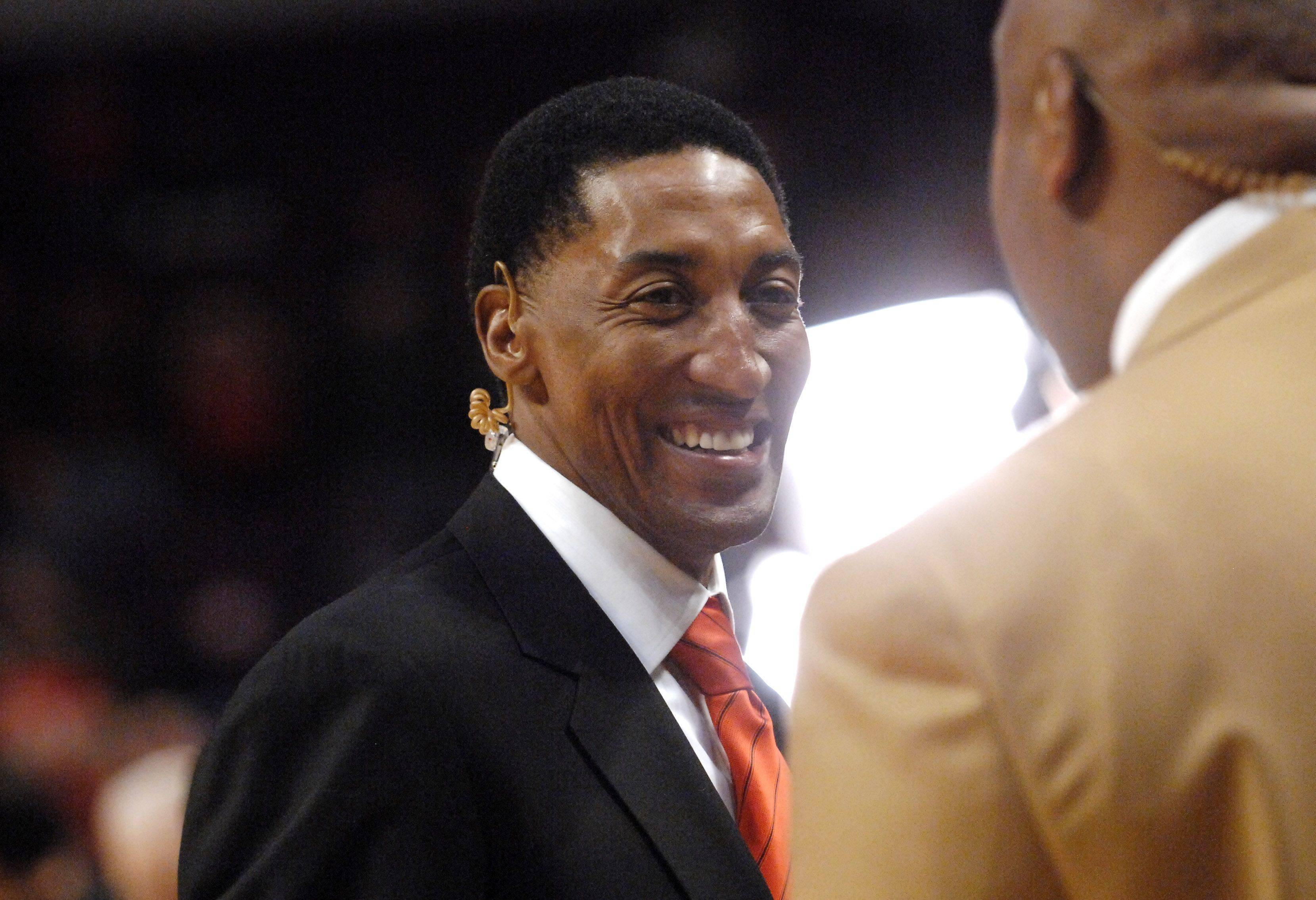 Former Bull Scottie Pippen chats with former teammate Stacy King before Game One of the NBA Eastern Conference Quarterfinals Saturday at the United Center in Chicago.