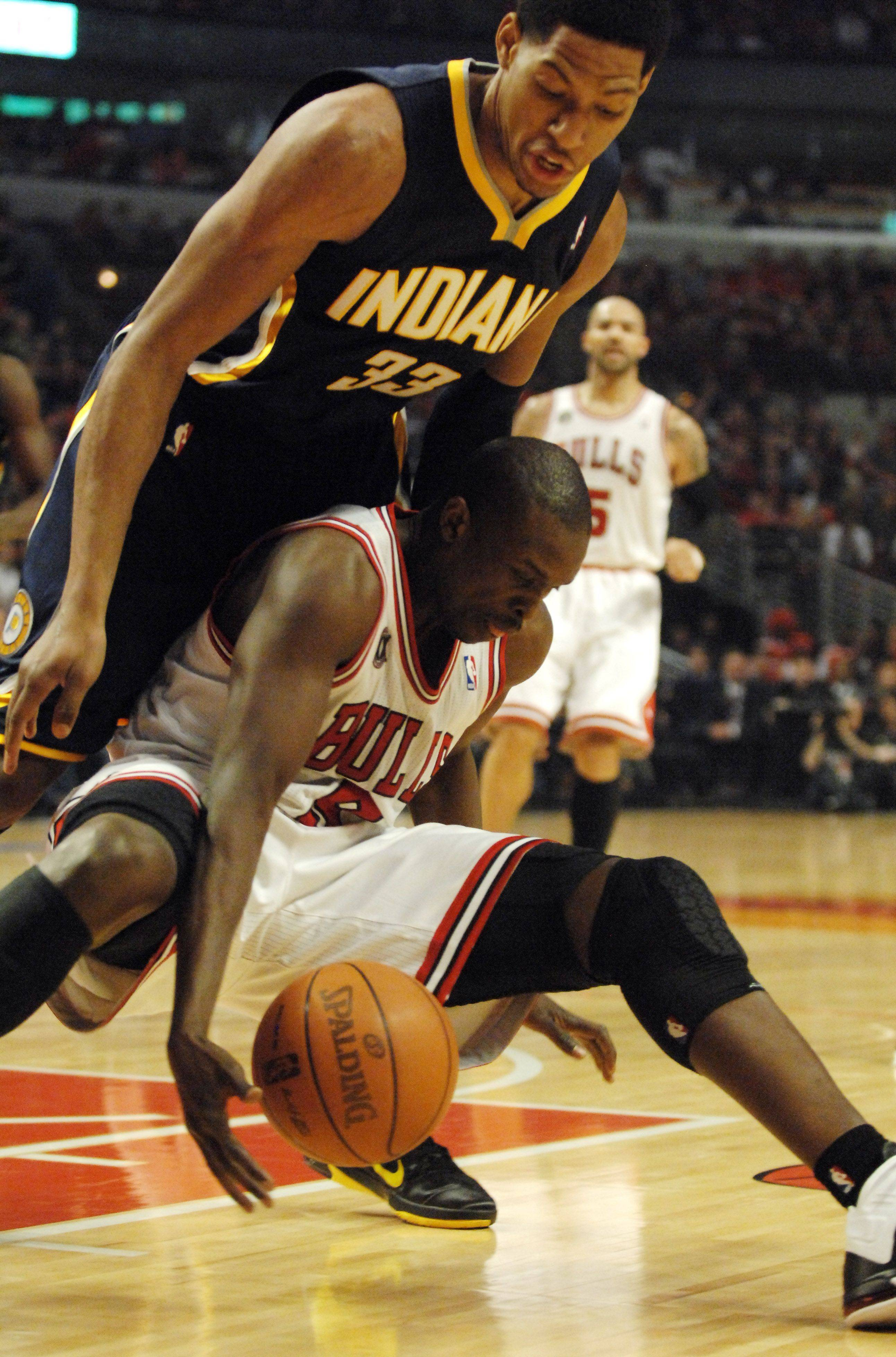 Chicago Bulls small forward Luol Deng (9) and Indiana Pacers small forward Danny Granger (33) battle for a loose ball during Game One of the NBA Eastern Conference Quarterfinals Saturday at the United Center in Chicago.