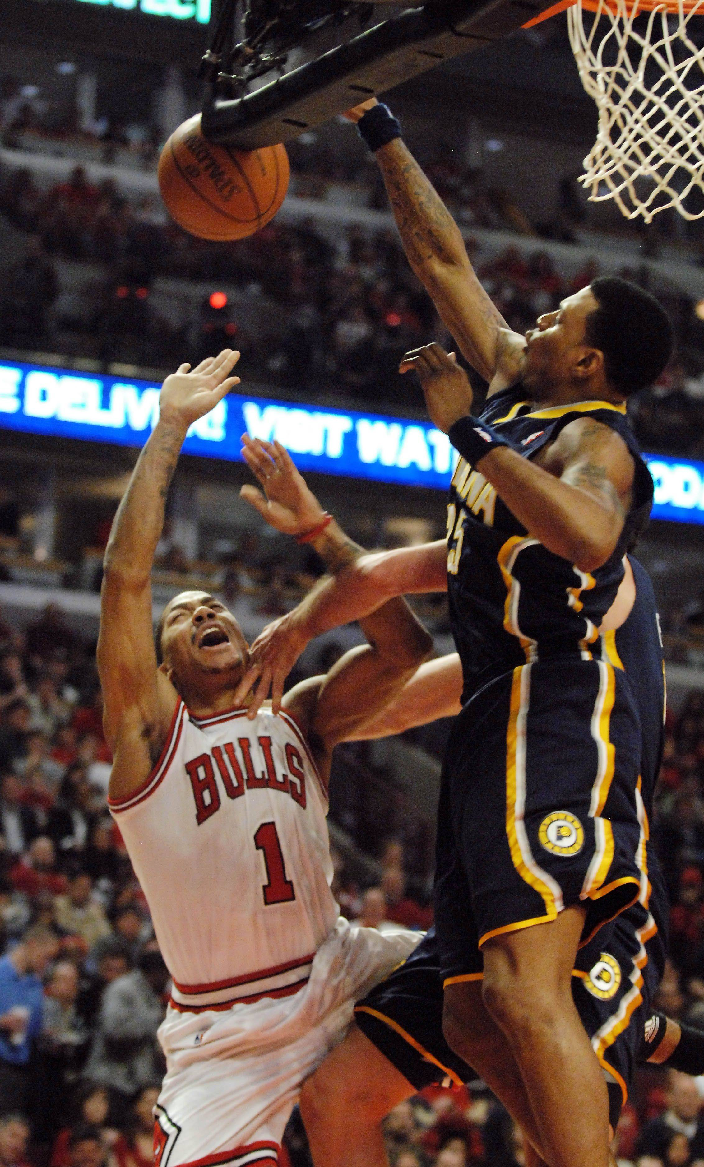 Chicago Bulls point guard Derrick Rose (1) gets fouled going to the basket by Indiana Pacers center Jeff Foster (10, not seen), igniting some tense words to be exchanged during Game One of the NBA Eastern Conference Quarterfinals Saturday at the United Center in Chicago.