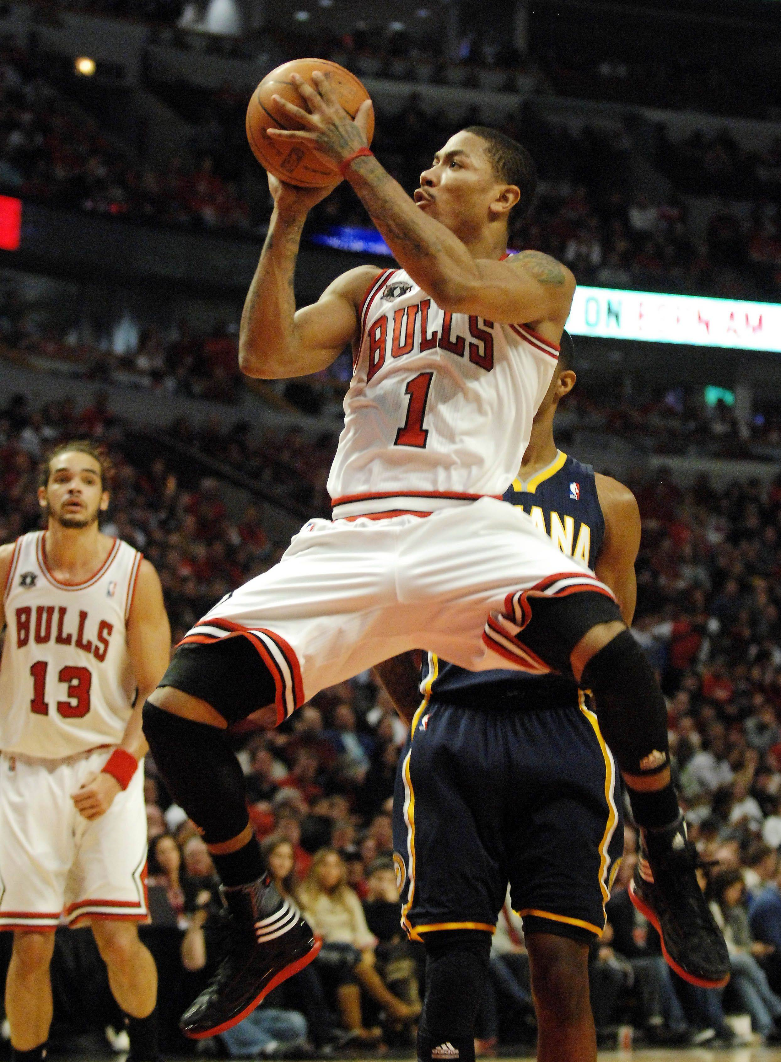 Chicago Bulls point guard Derrick Rose (1) glides to the basket and scores during Game One of the NBA Eastern Conference Quarterfinals Saturday at the United Center in Chicago.