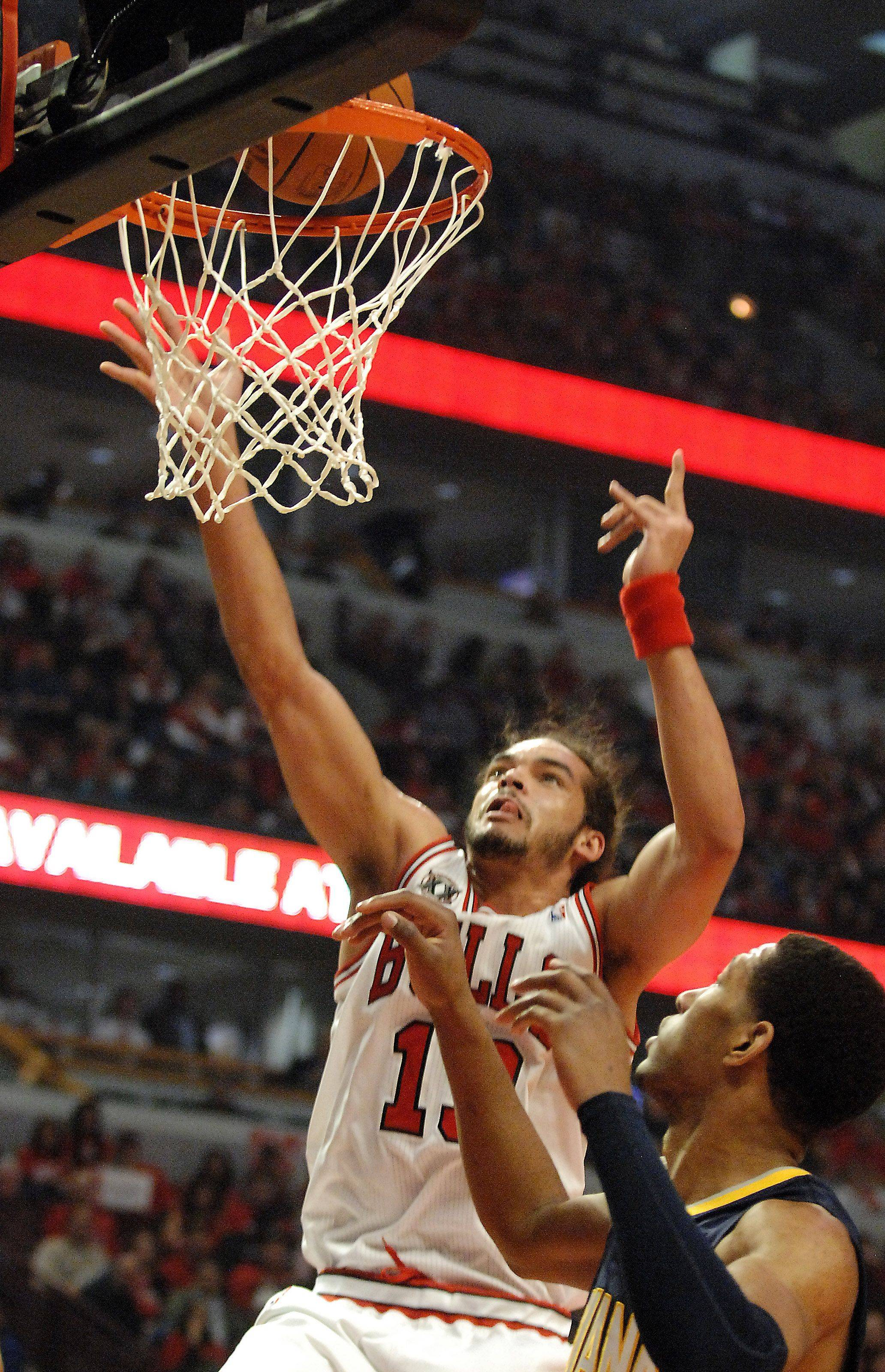 Chicago Bulls center Joakim Noah (13) tips in a basket during Game One of the NBA Eastern Conference Quarterfinals Saturday at the United Center in Chicago.