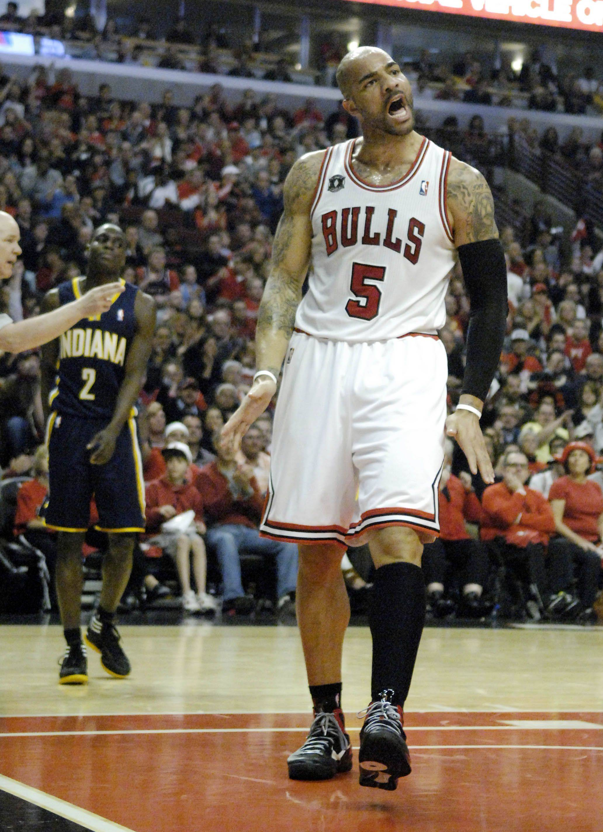 Chicago Bulls power forward Carlos Boozer (5) exults after being fouled on a made shot during Game One of the NBA Eastern Conference Quarterfinals Saturday at the United Center in Chicago.