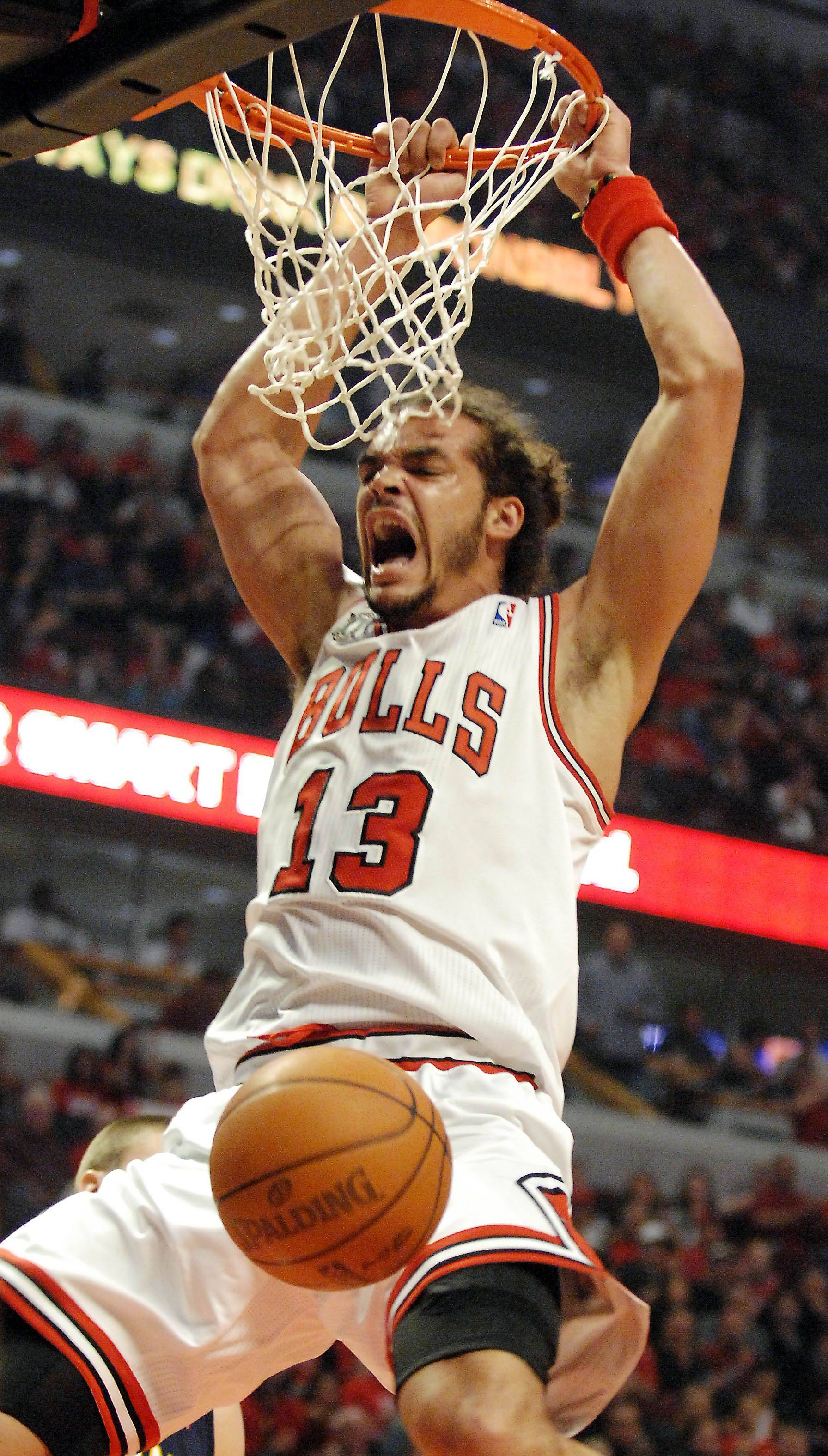 Chicago Bulls center Joakim Noah (13) throws down a first quarter dunk during Game One of the NBA Eastern Conference Quarterfinals Saturday at the United Center in Chicago.