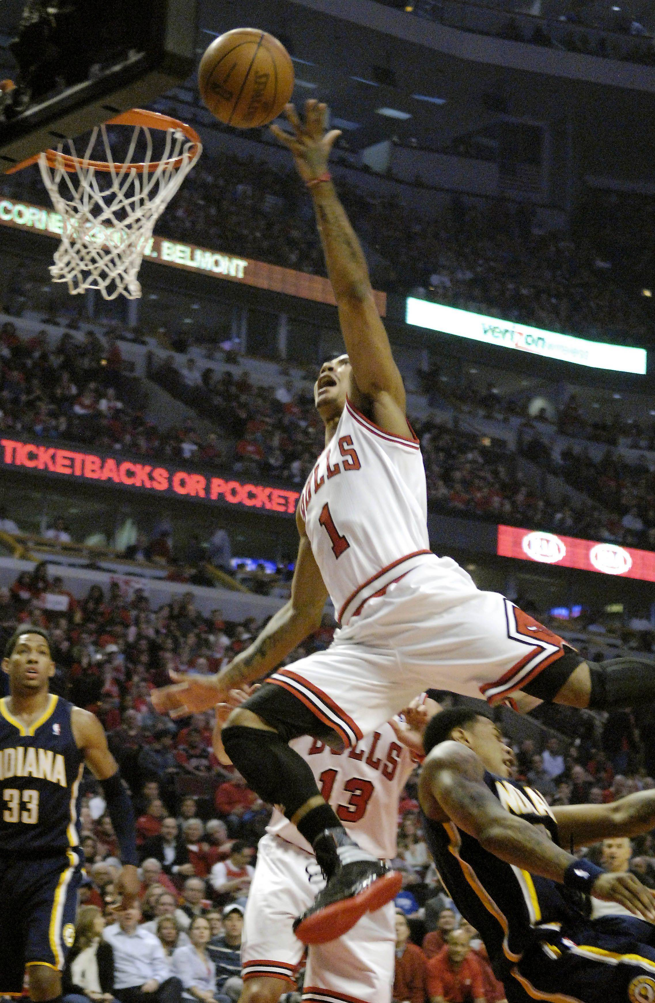 Chicago Bulls point guard Derrick Rose (1) gets upended as he drives and scores in the first quarter during Game One of the NBA Eastern Conference Quarterfinals Saturday at the United Center in Chicago.