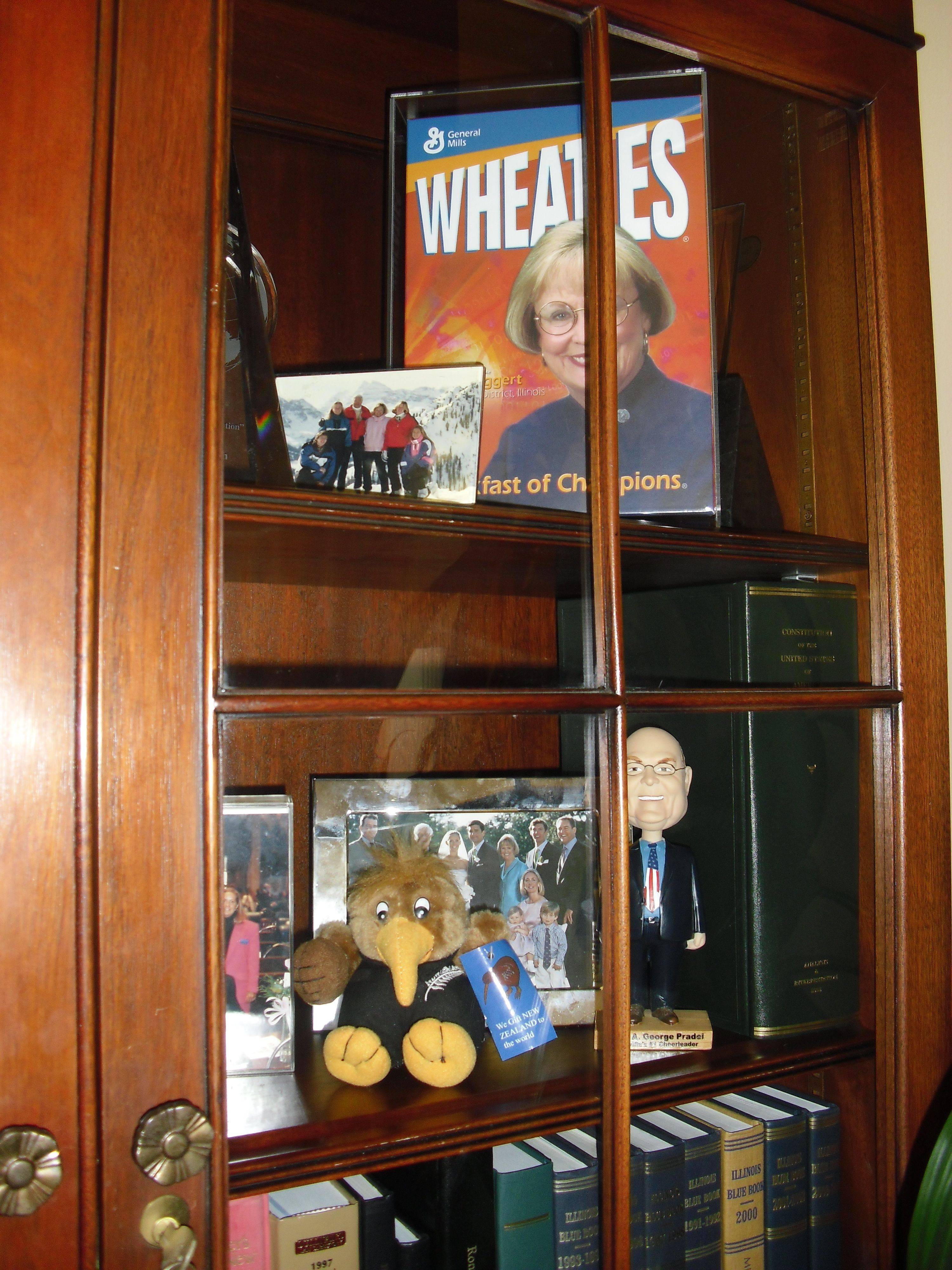 Congresswoman Judy Biggert keeps personal items in a cabinet in her office, including a personalized Wheaties box and a bobblehead doll of Naperville Mayor George Pradel.