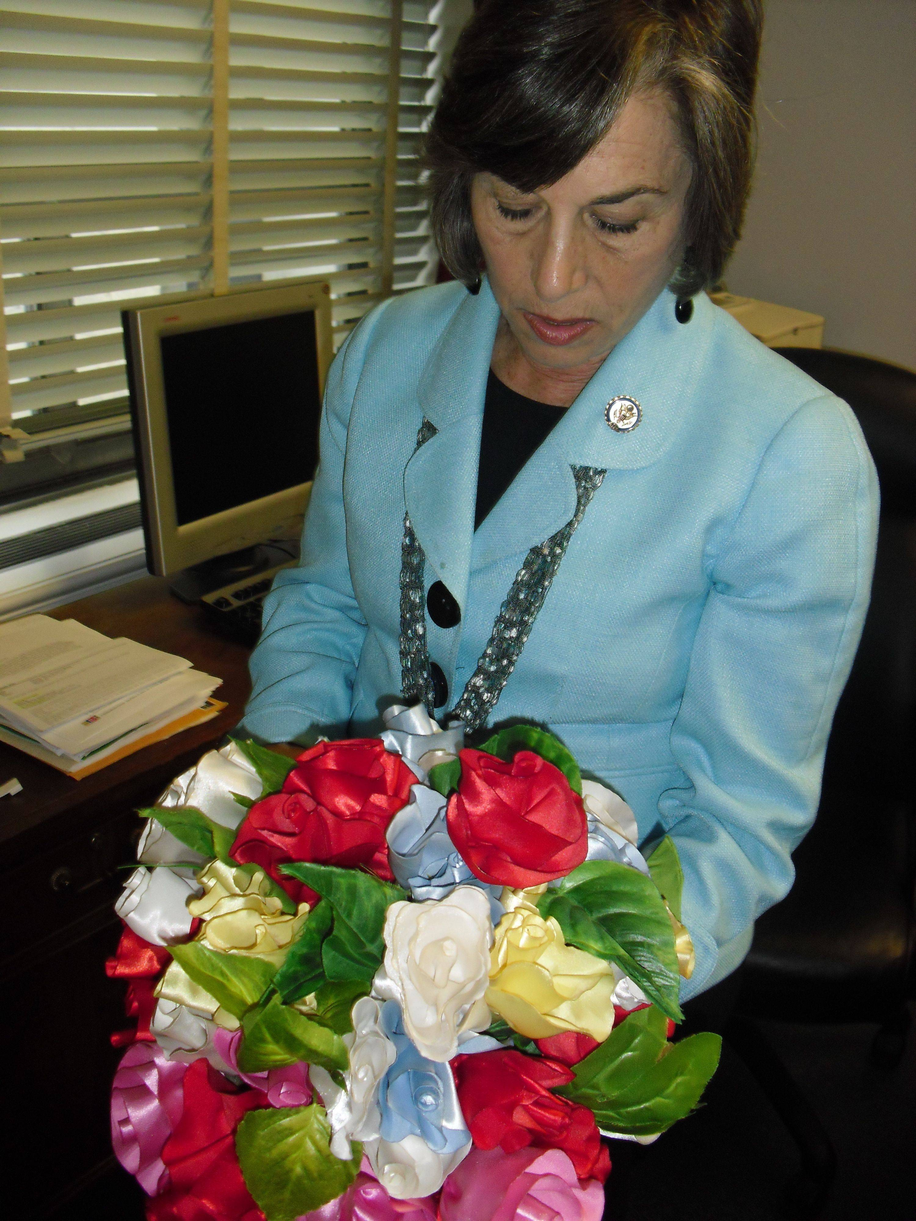 Evanston Democrat Rep. Jan Schakowsky admires a bouquet of handmade flowers given to her on a trip to the Democratic Republic of Congo.