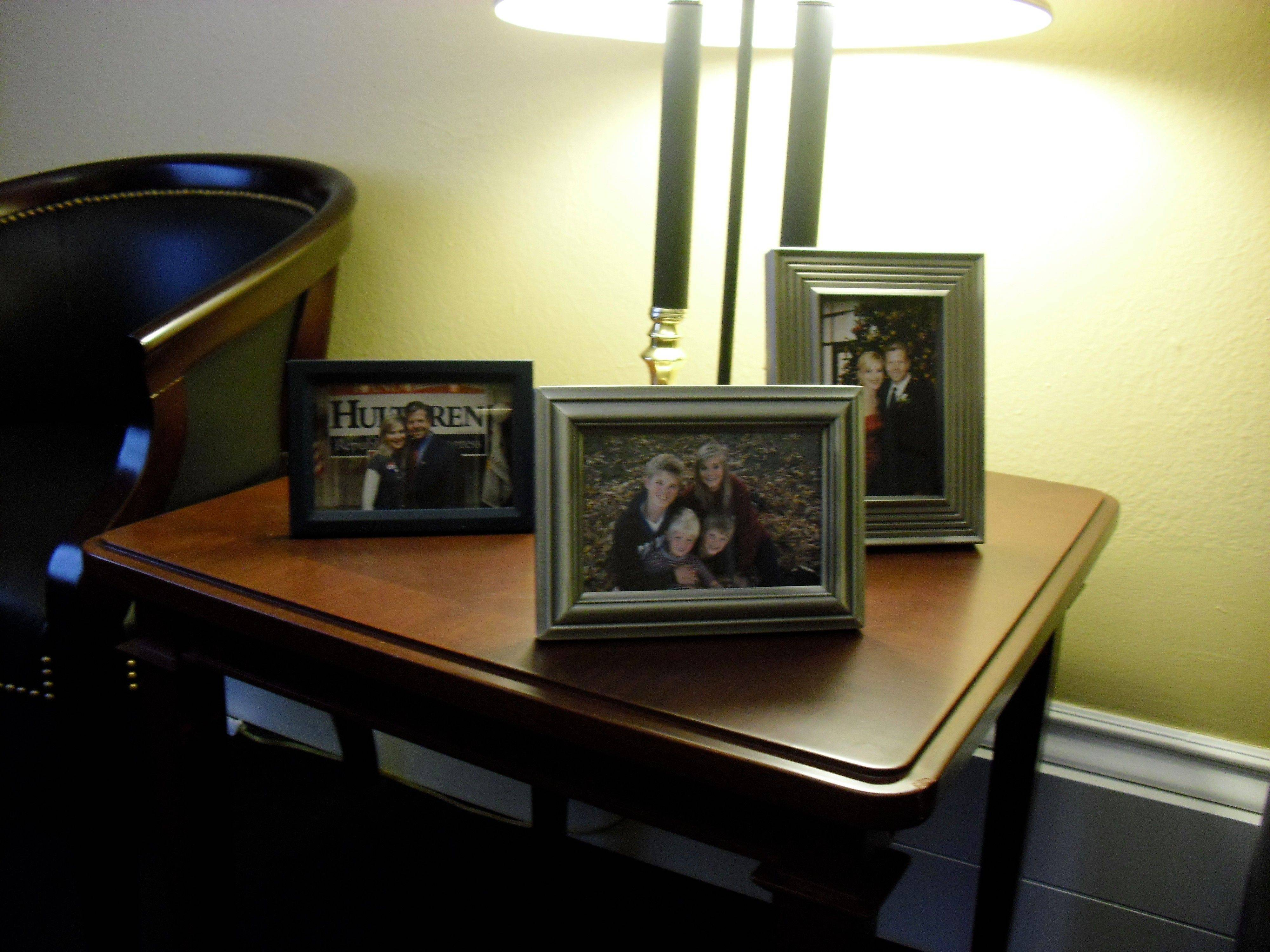 Photos of U.S. Rep. Randy Hultgren's family sit on table in his Washington, D.C., office.