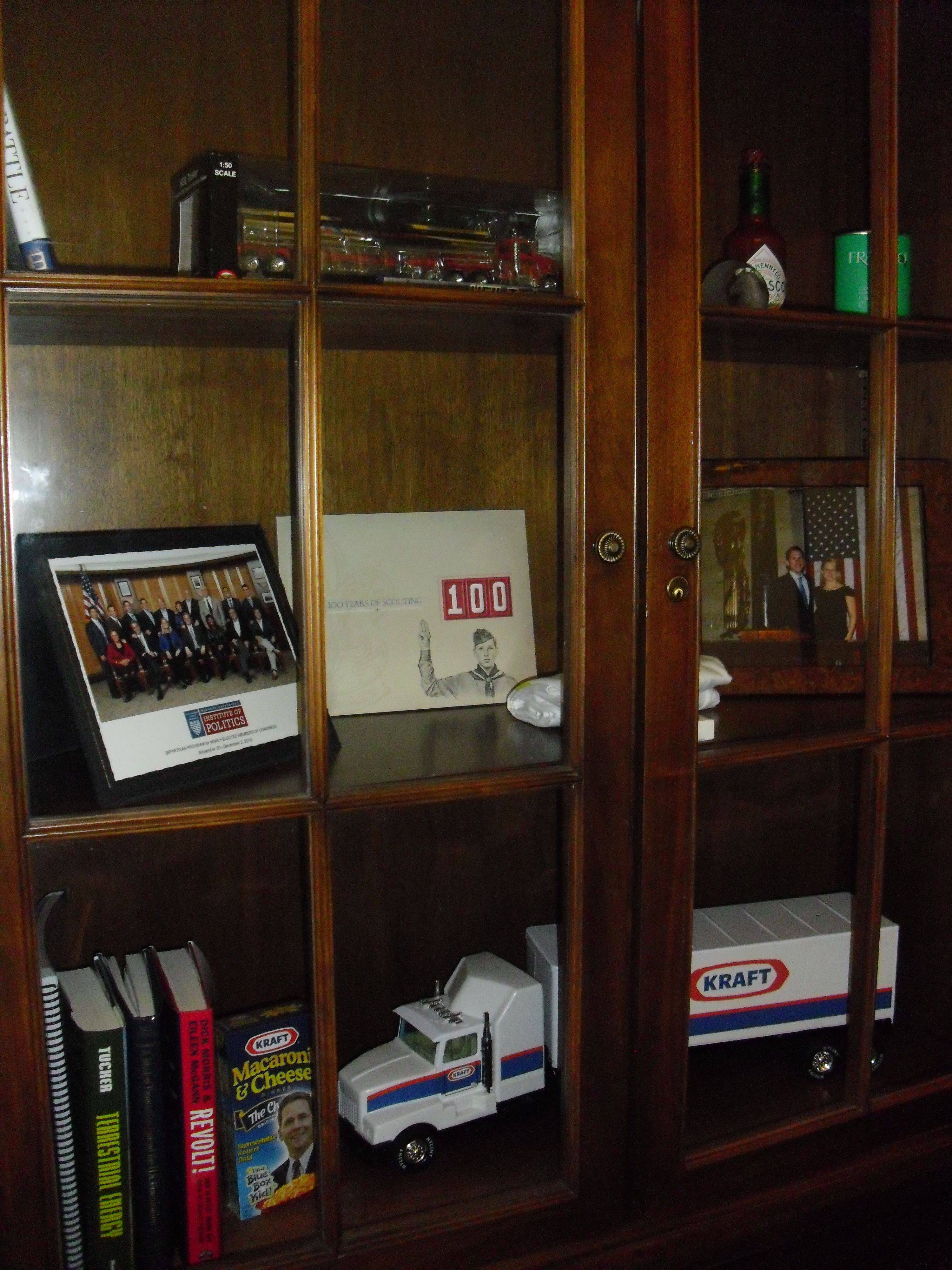 U.S. Rep. Robert Dold's office cabinet contains items including a toy truck from Kraft, some macaroni and cheese and books.