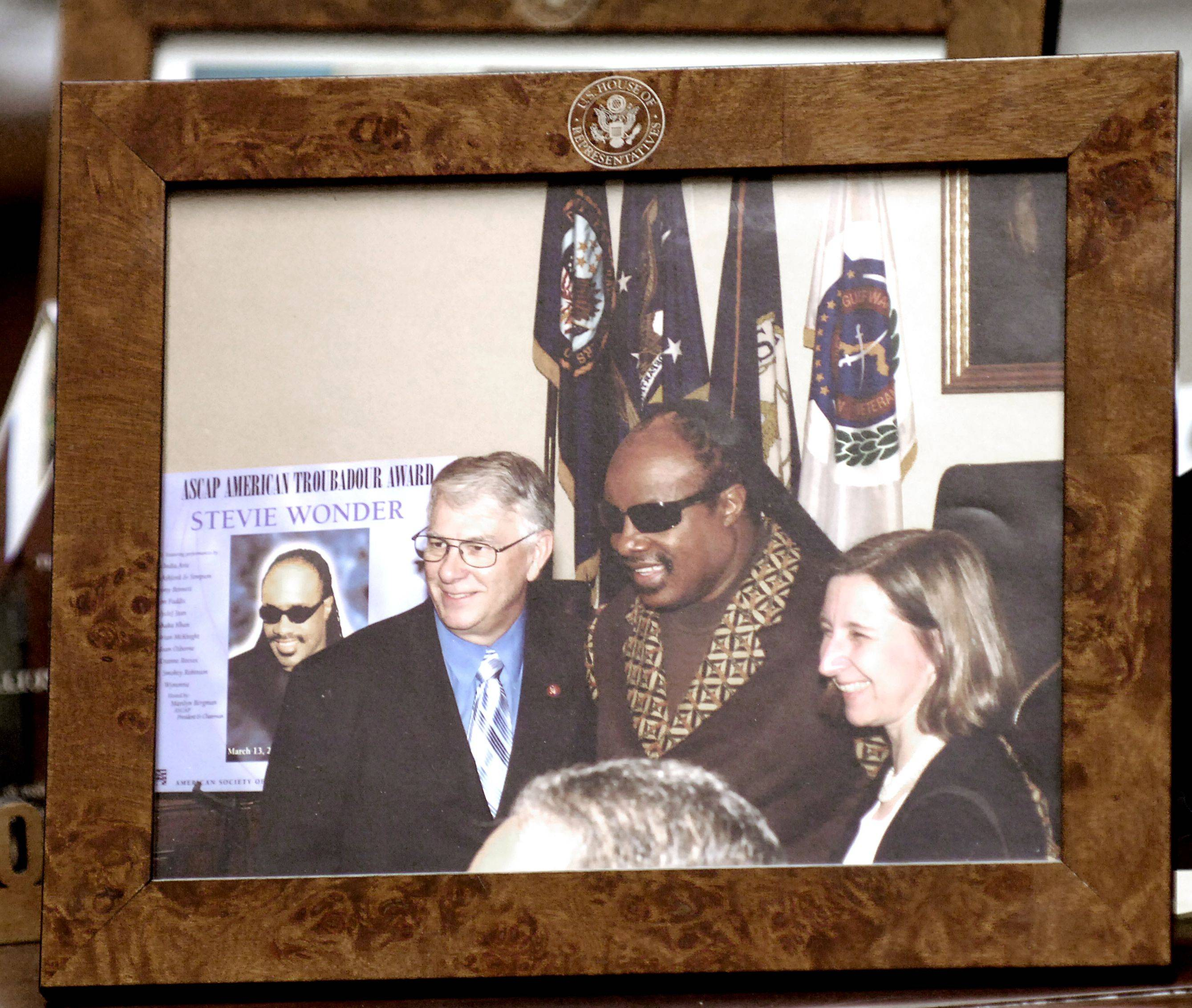 A picture of Congressman Don Manzullo of Egan with musician Stevie Wonder is among the photos with VIPs, awards and other mementos decorating his Washington, D.C. office.