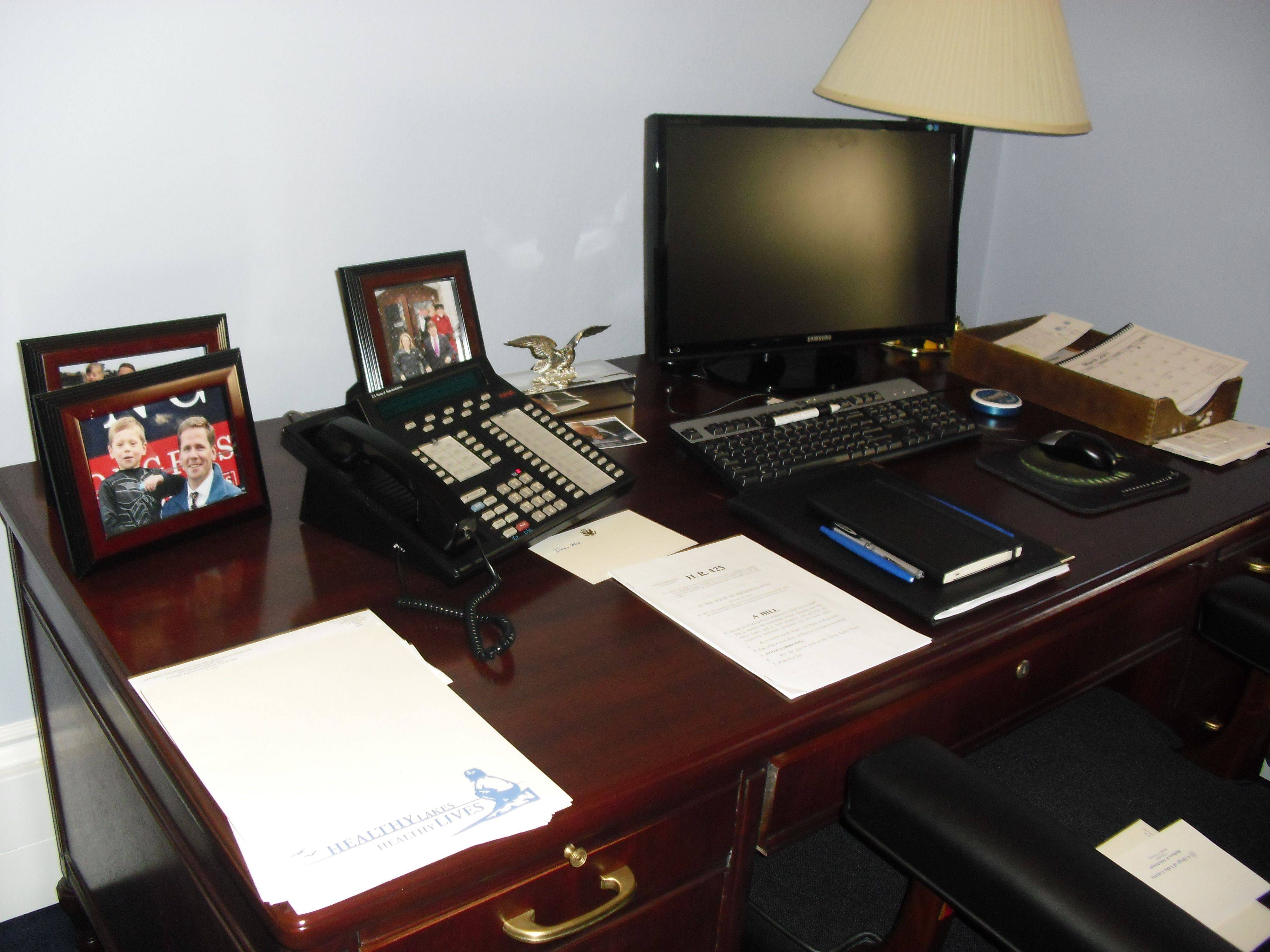 Freshman Congressman Robert Dold keeps family photos on his desk, including one of him and his son.