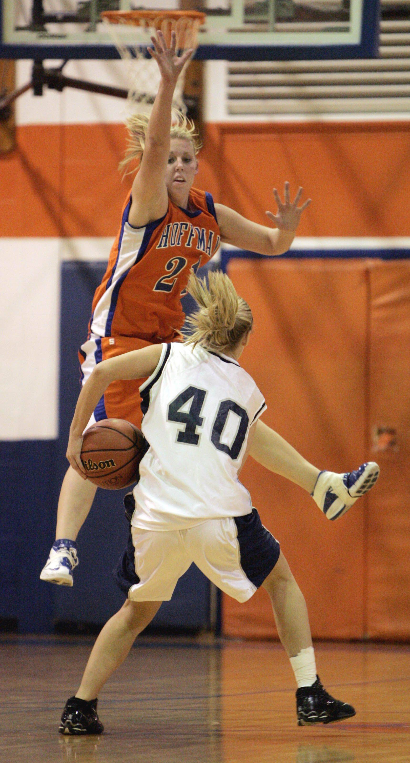 ED LEE/elee@dailyherald.com Hoffman Estates 21 Alex Wulbecker with the tight defense on Lake