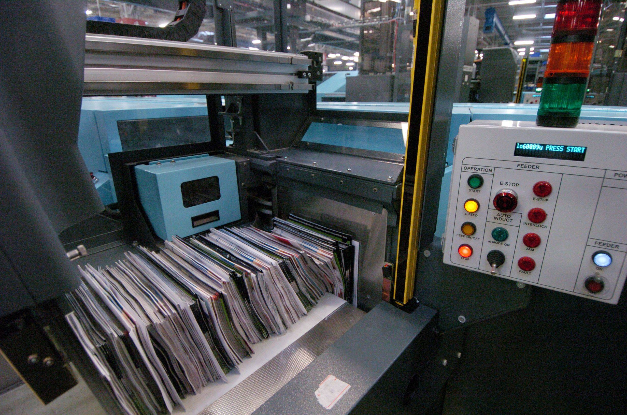 A new flat sequencing system machine processes large envelopes, magazines and catalogs at the Palatine Processing and Distribution Center on Northwest Highway.