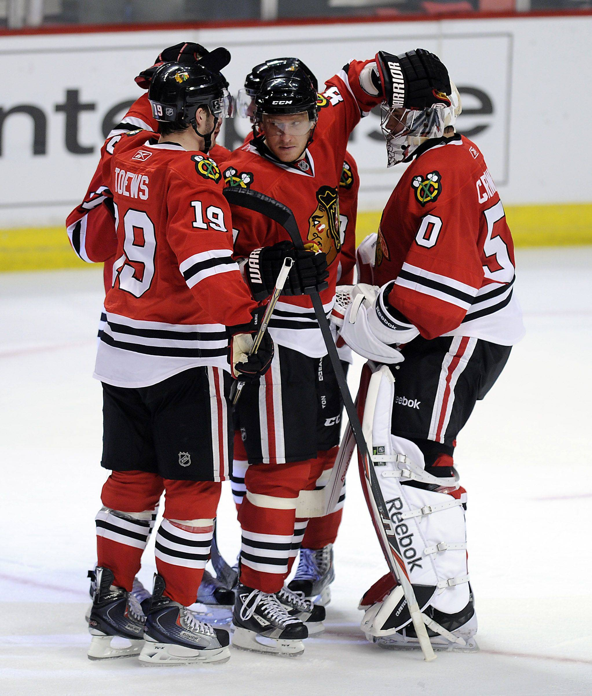 Mark Welsh/mwelsh@dailyherald.comBlackhawks Marian Hossa celebrates with the rest of his teammates after beating the Canucks 7-2 in game 4 of the NHL playoff game at the United Center in Chicago on Tuesday.