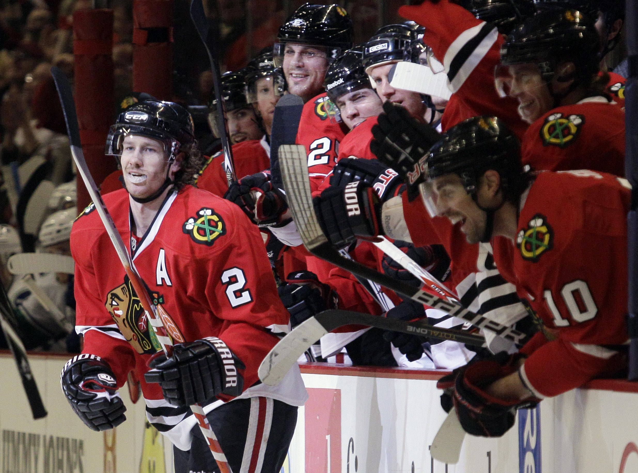 Chicago Blackhawks defenseman Duncan Keith (2) celebrates his second-period goal with his teammates .