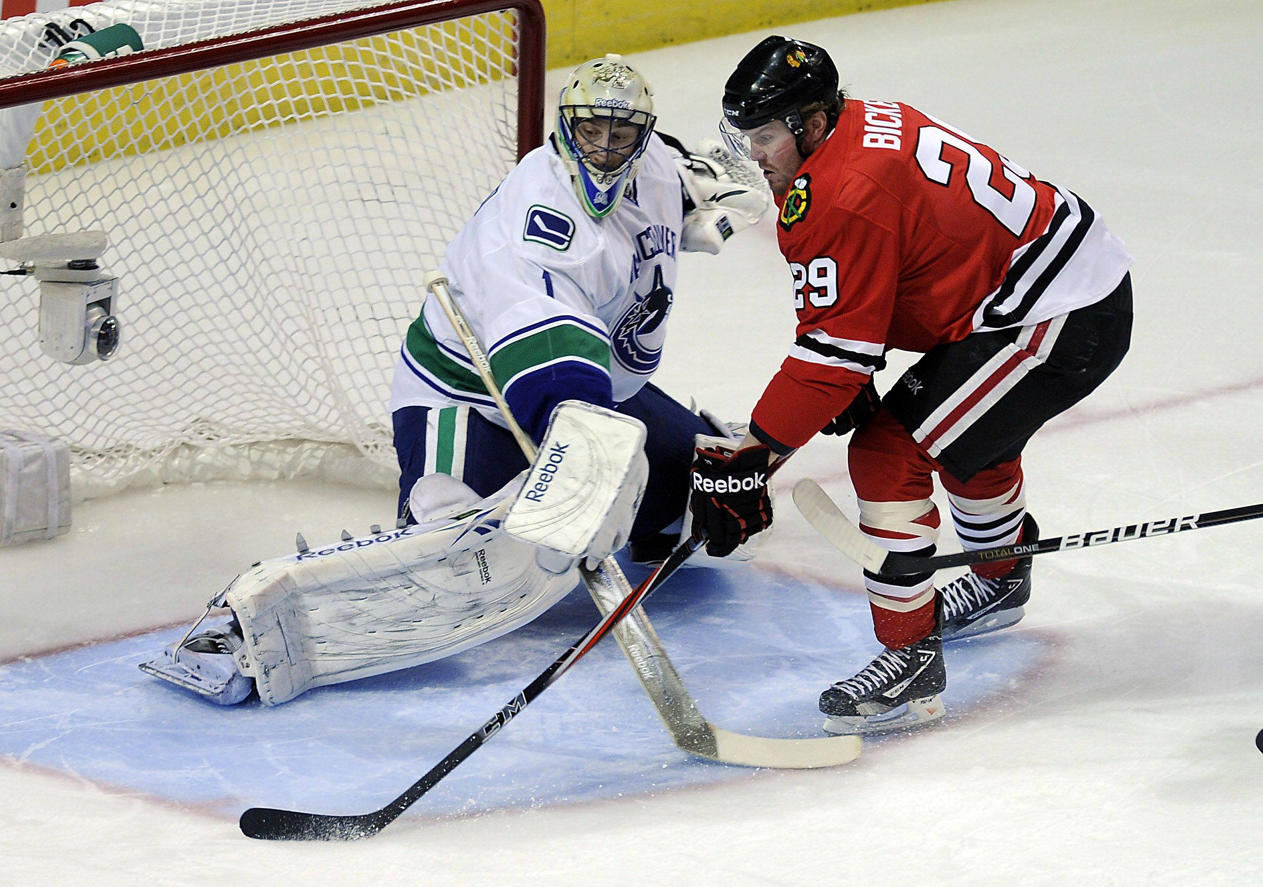 Bryan Bickell scores on Canucks goalie Roberto Luongo in the first period.