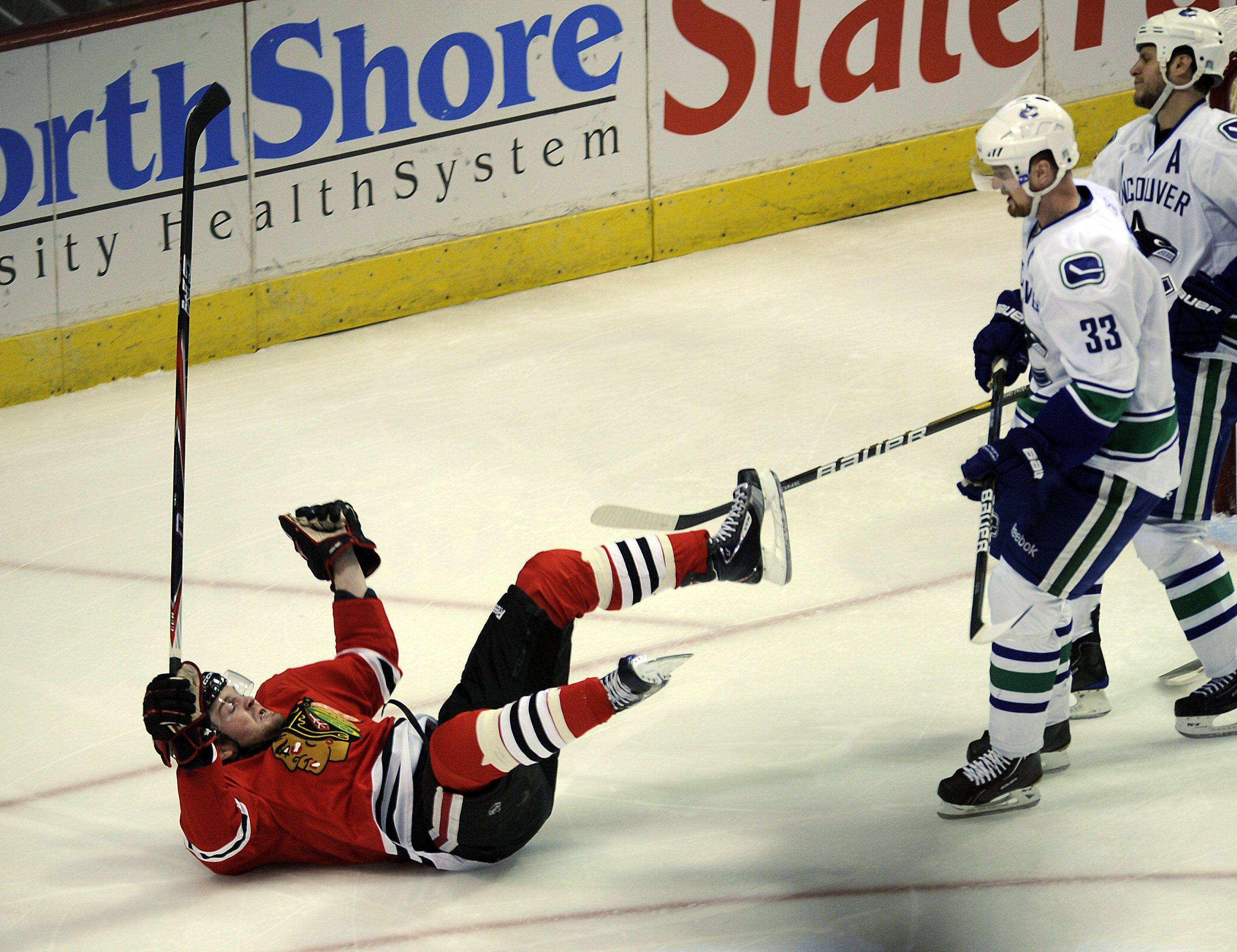 Bryan Bickell falls on the ice after scoring in the first period.