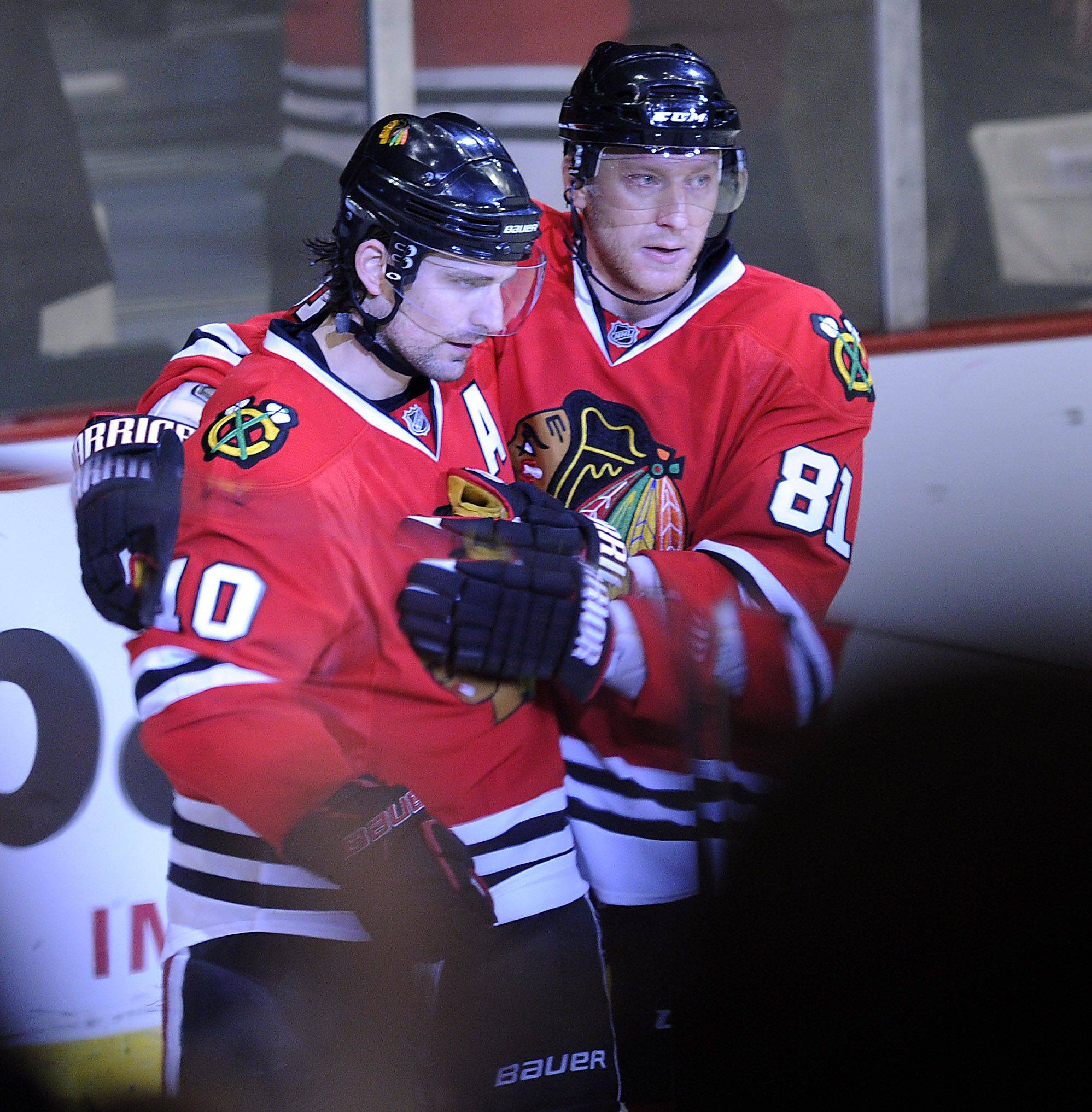 Patrick Sharp celebrates his third-period goal with teammate Marian Hossa.