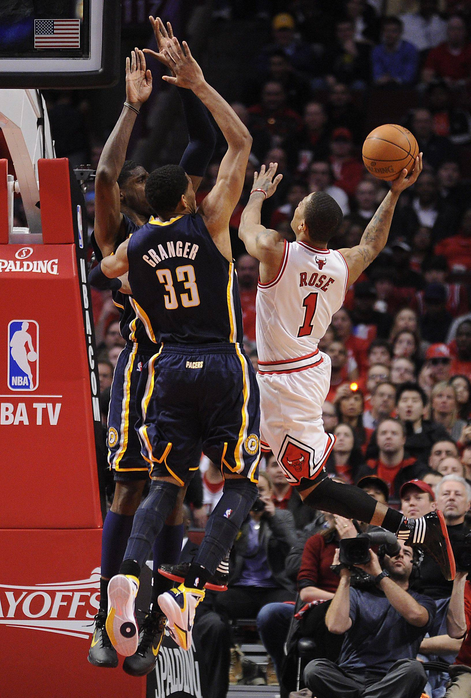 Derrick Rose goes up against Pacer Danny Granger in the second half.