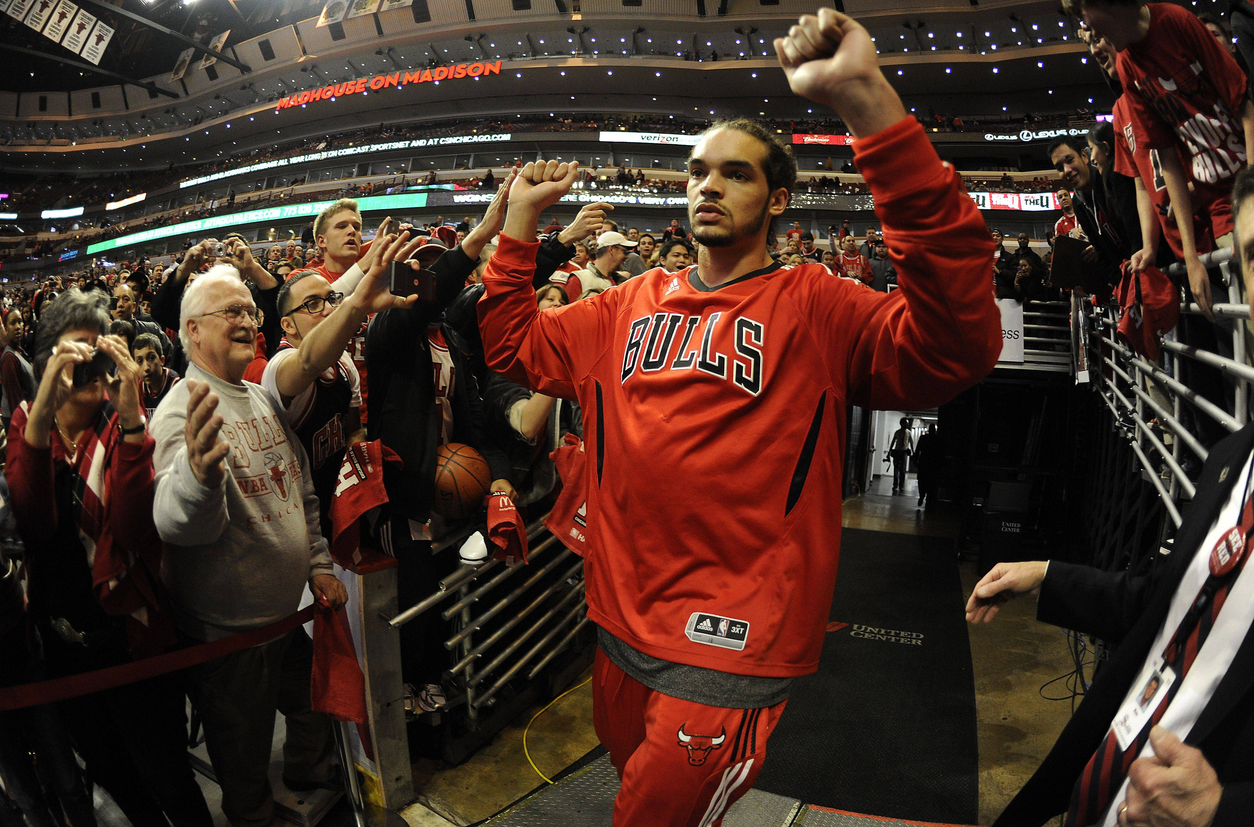 Joakim Noah enters the United Center floor.
