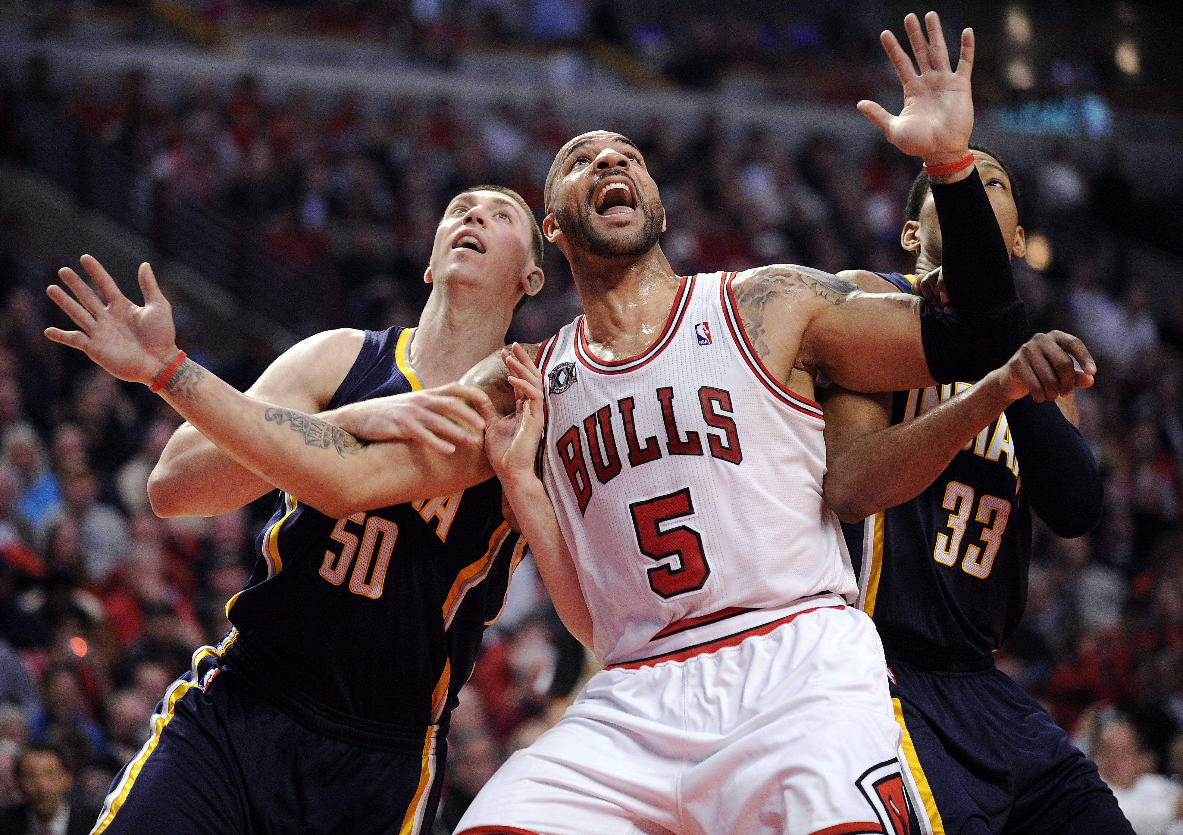 Carlos Boozer fends off Pacers Roy Hibbert and Josh McRoberts for a rebound in the second quarter.