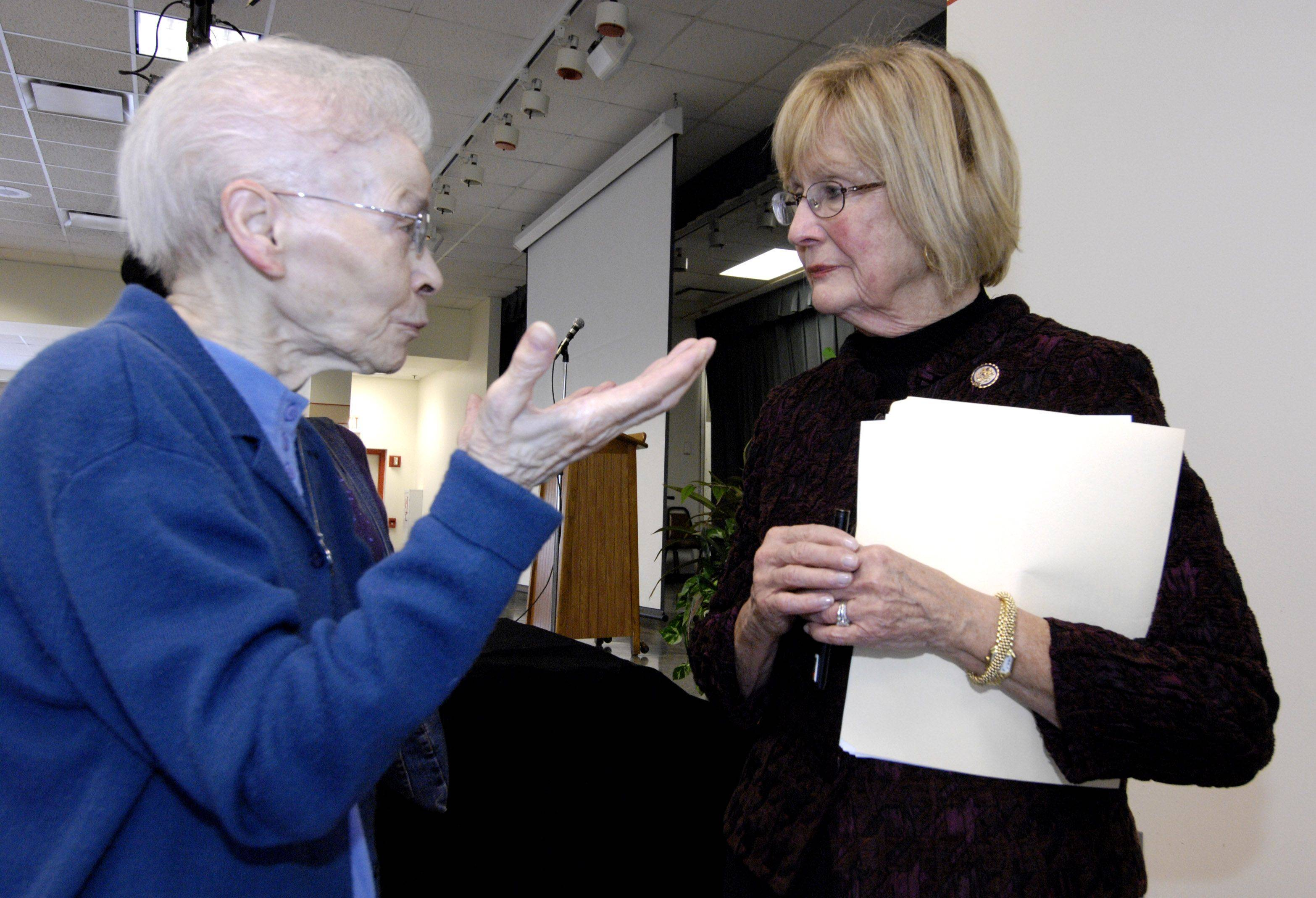 Yolanda Gentile talks with U.S. Rep. Judy Biggert after a town-hall meeting on the 2012 federal budget Wednesday at Mayslake Village in Oak Brook.
