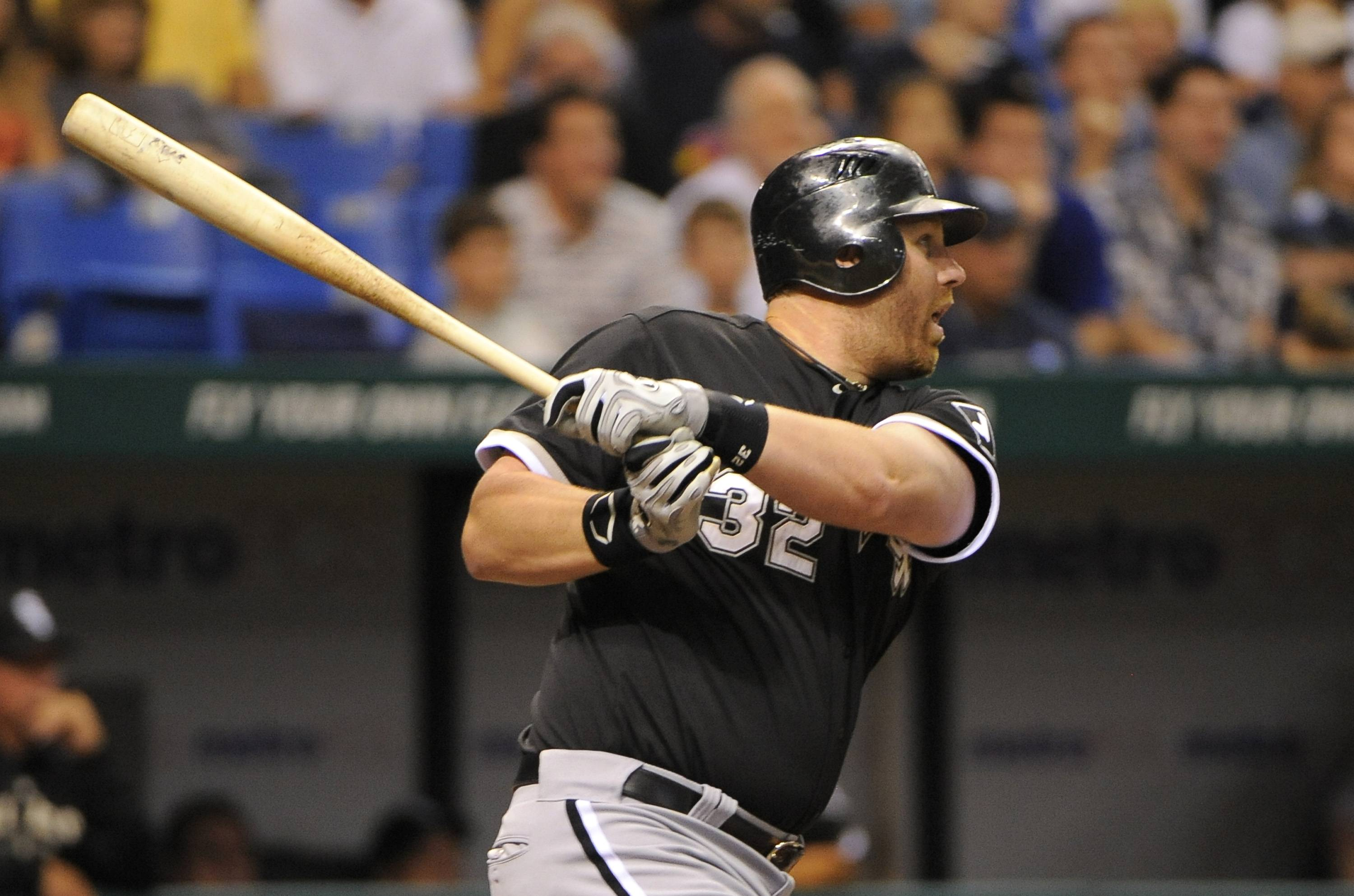 Adam Dunn follows through after hitting a double against the Tampa Bay Rays during the sixth inning Wednesday in St. Petersburg, Fla.