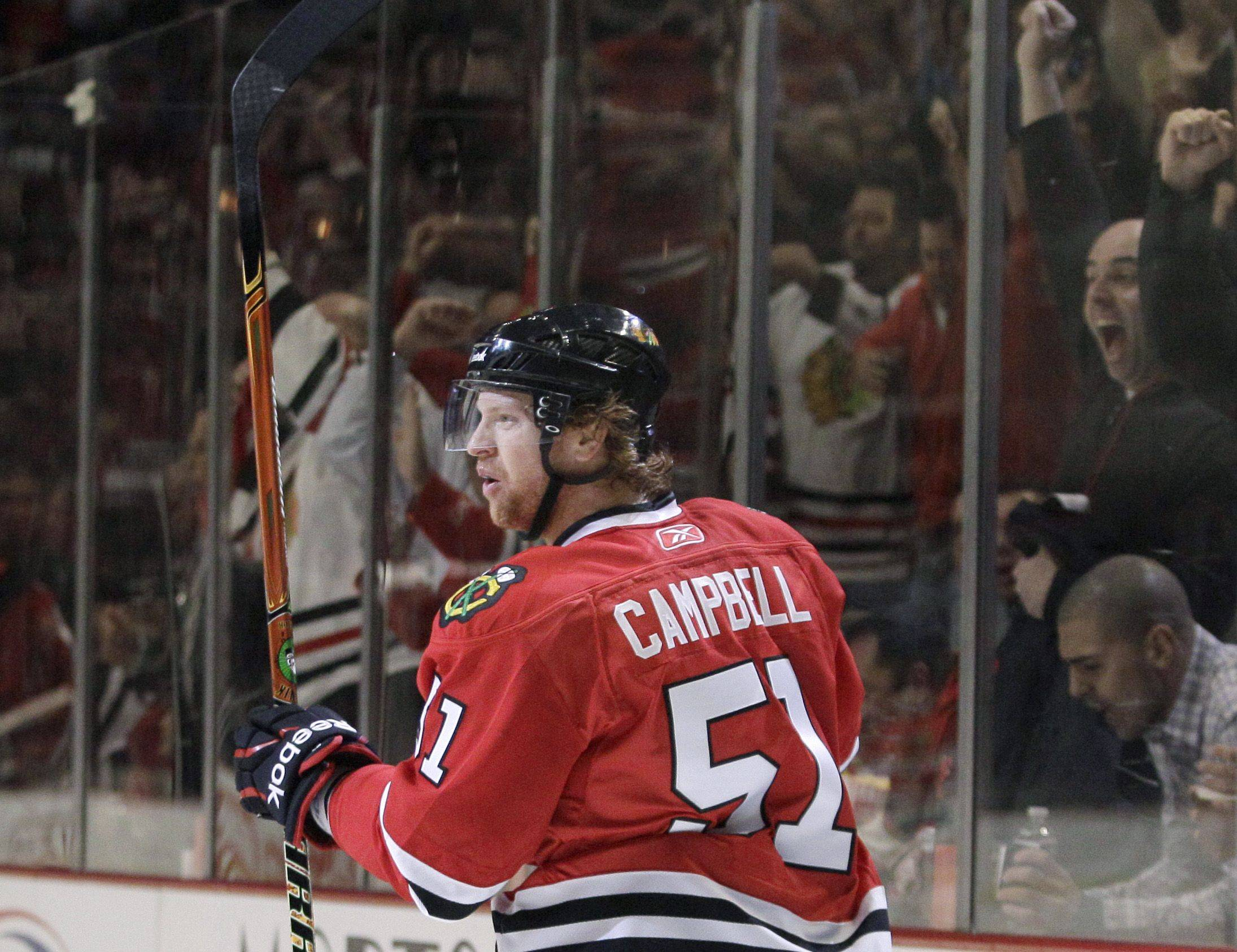 Chicago Blackhawks defenseman Brian Campbell reacts after scoring a goal during the second period in Game 4 of an NHL hockey Stanley Cup playoffs first-round series against the Vancouver Canucks on Tuesday, April 19, 2011, in Chicago.