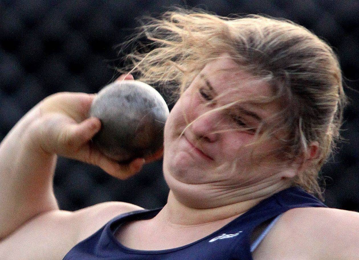 Cary-Grove's Anna Wcislo competes in the shot put during the McHenry County Track and Field Meet at Metcalf Field on the campus of Crystal Lake Central on Wednesday evening.