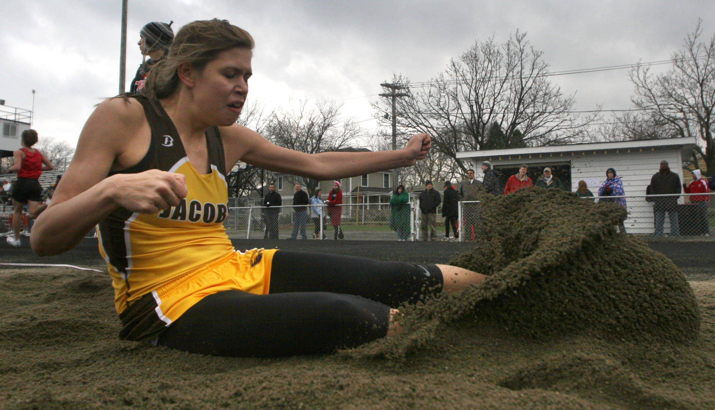 Jacobs' Allie Virgilio comes in for a landing in the triple jump finals during the McHenry County Track and Field Meet at Metcalf Field on the campus of Crystal Lake Central on Wednesday evening. Virgilio won the event with a jump of 36 feet, 1 inch.